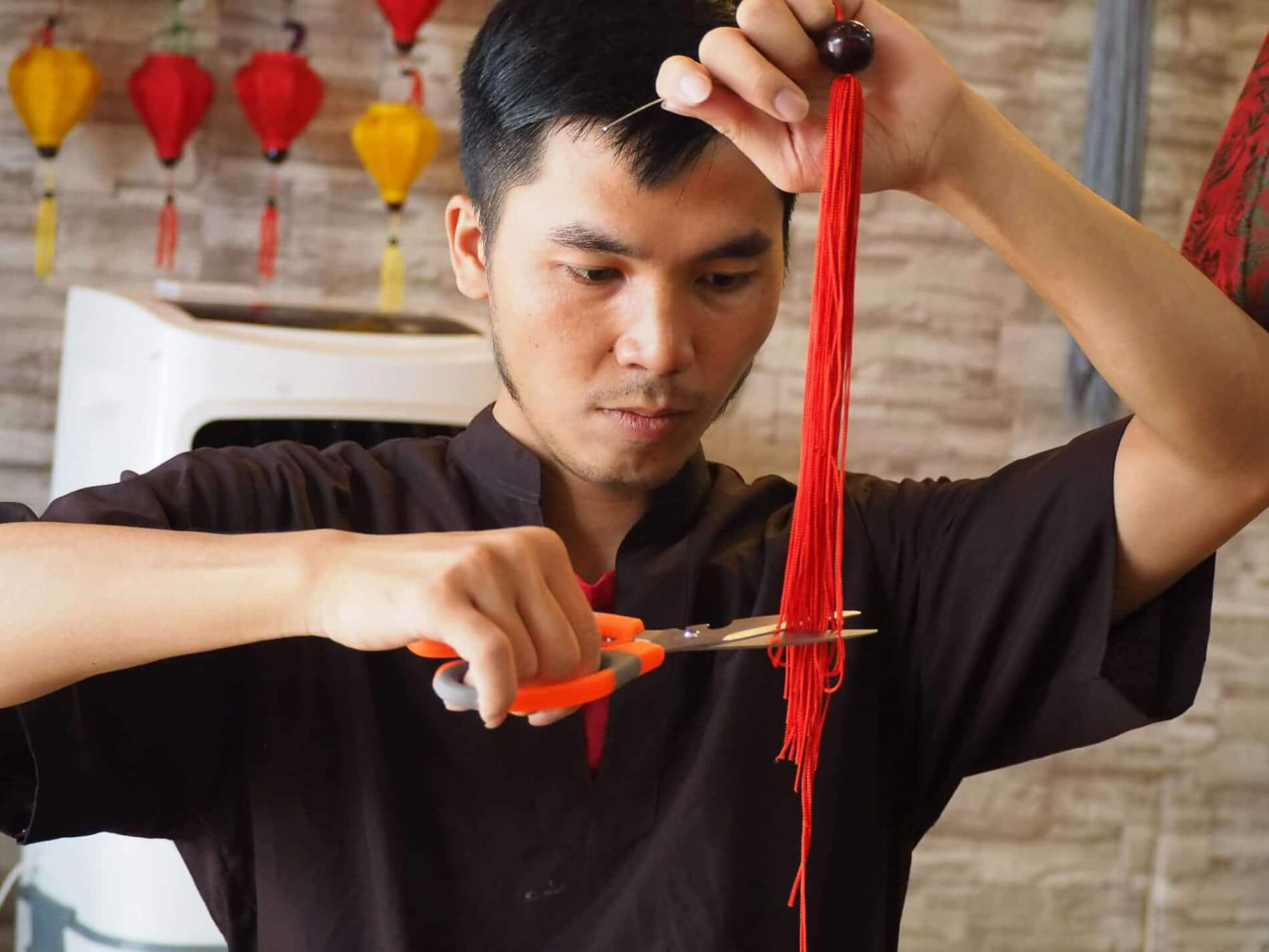 Hoi An Handicraft Tours - lantern making - cutting the strings