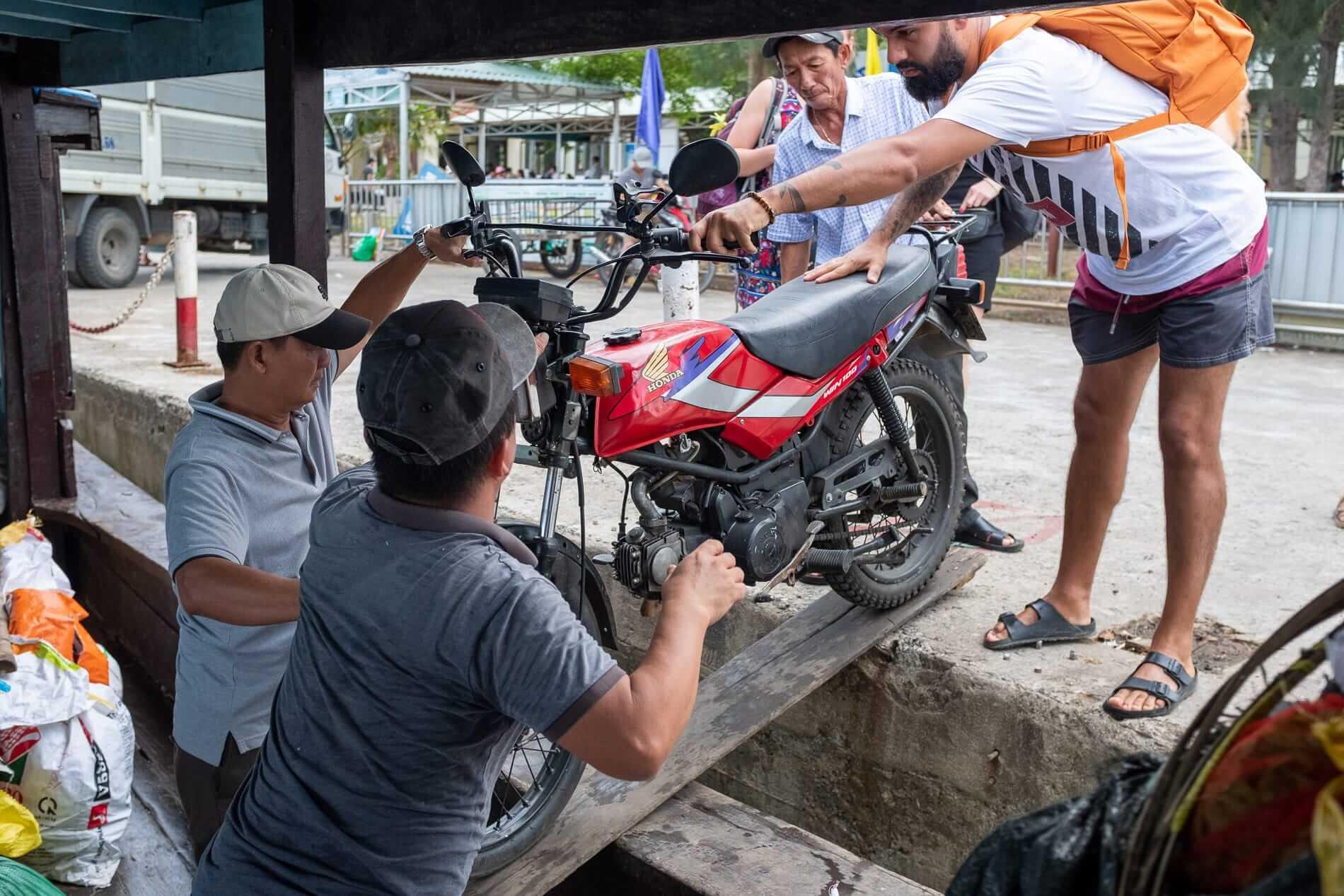Motorbike loaded onto a boat