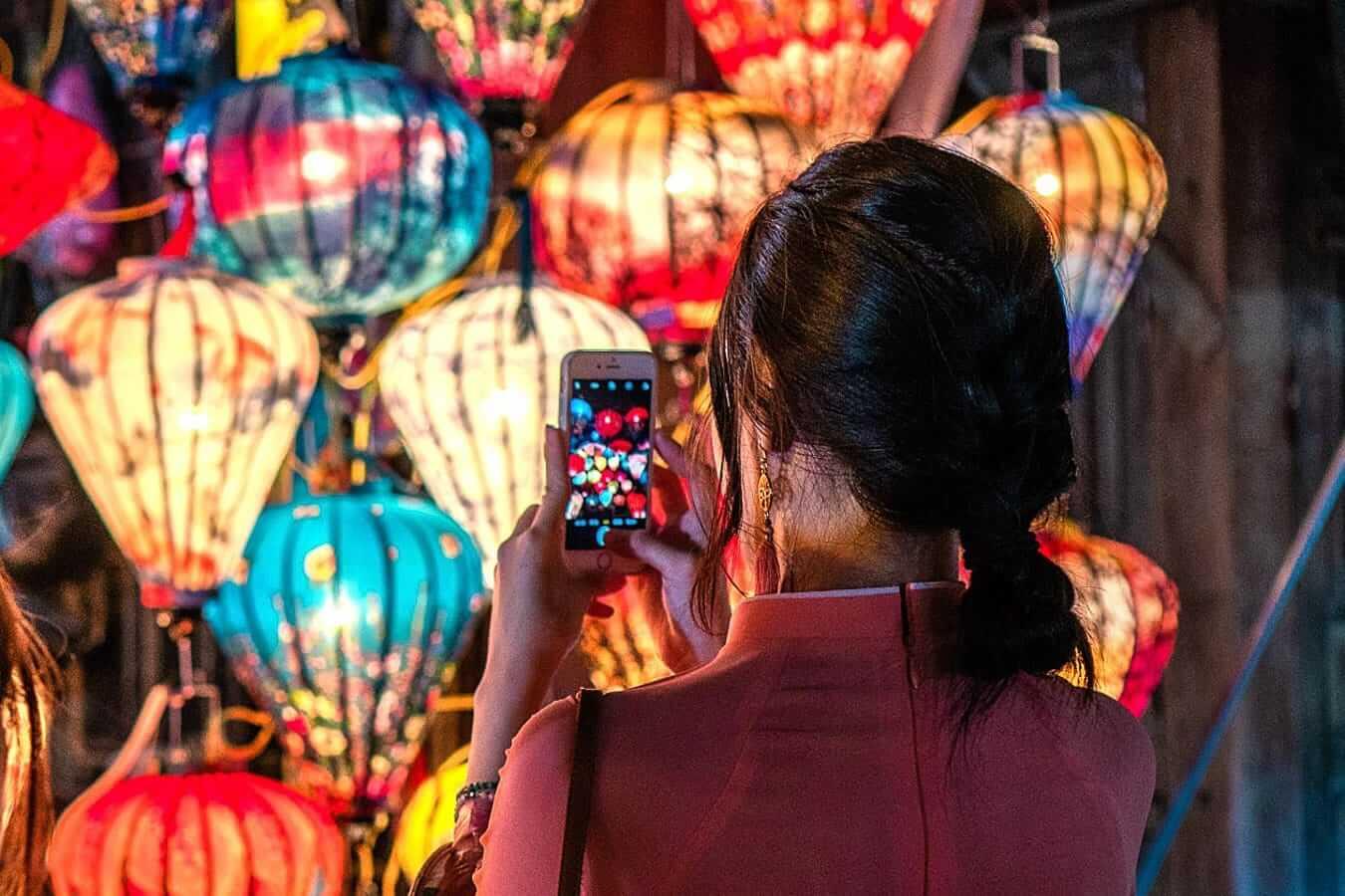 Woman taking a photo: lantern shopping