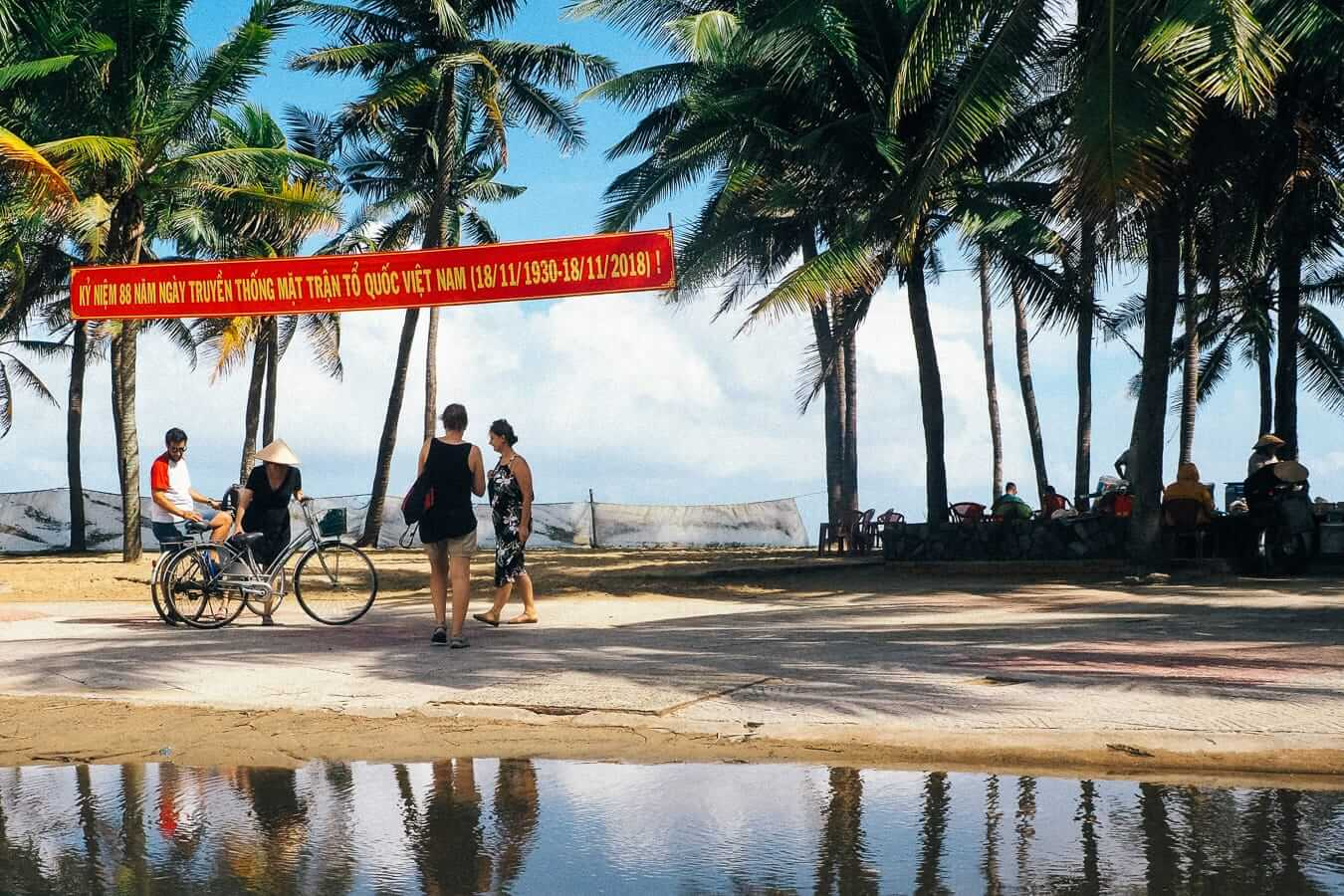 Beachgoers parking their bikes at Cua Dai Beach