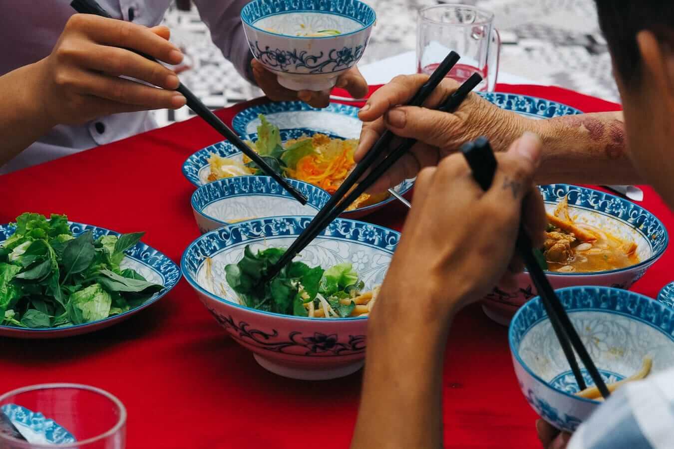 Chopsticks dip into bowls