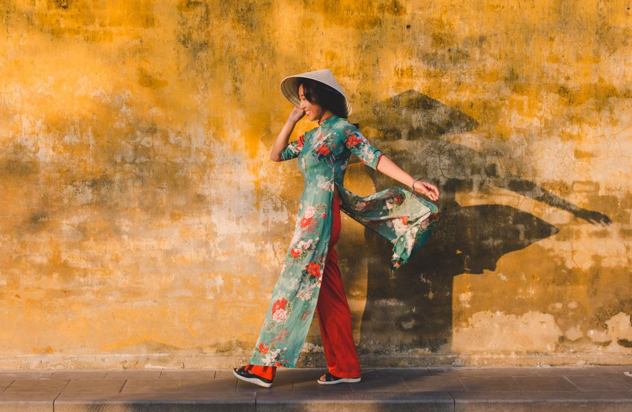 Ao Dai against a yellow wall