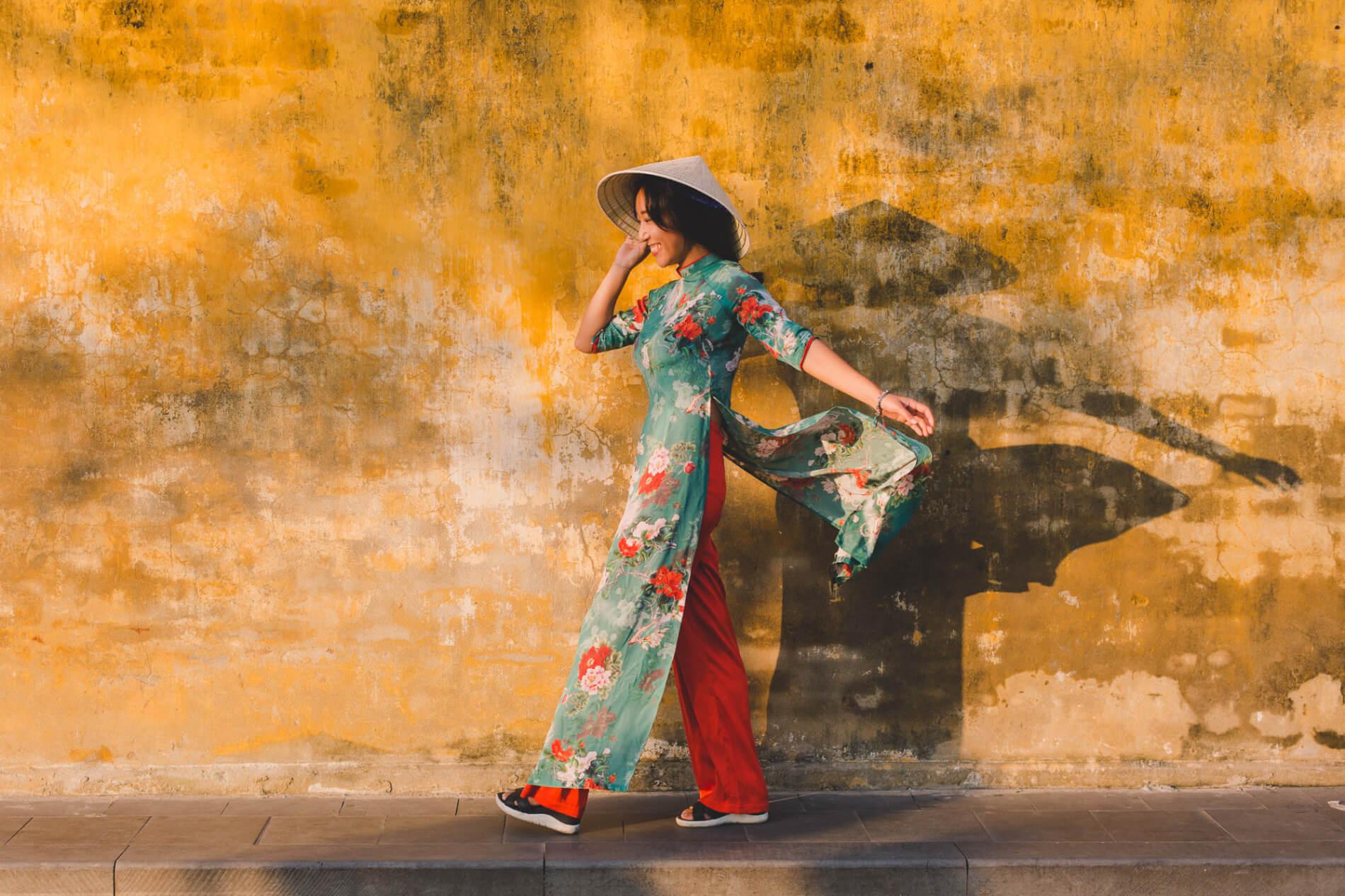 Ao Dai against a yellow wall