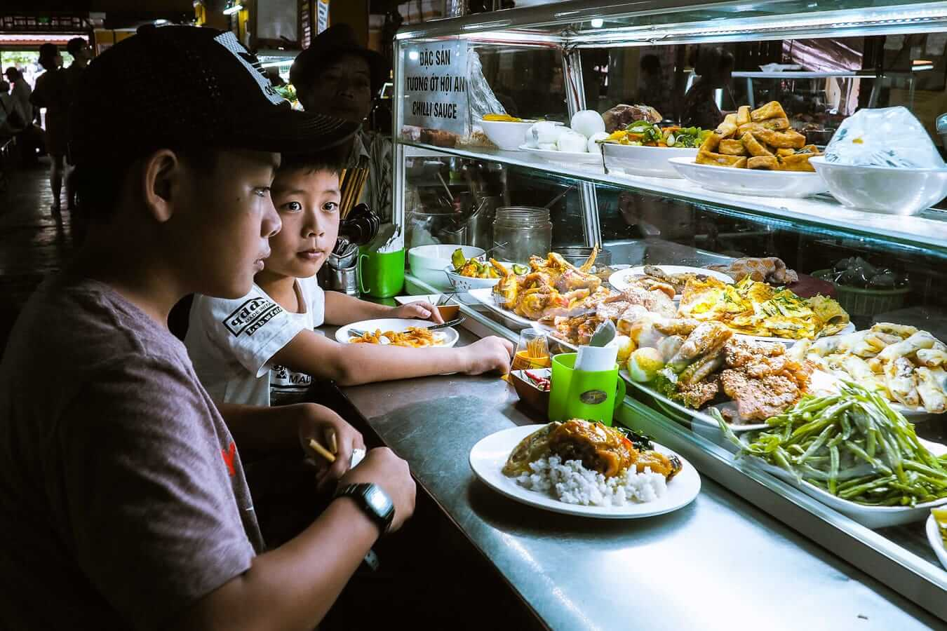 Boys having lunch in Hoi An Central Food Market