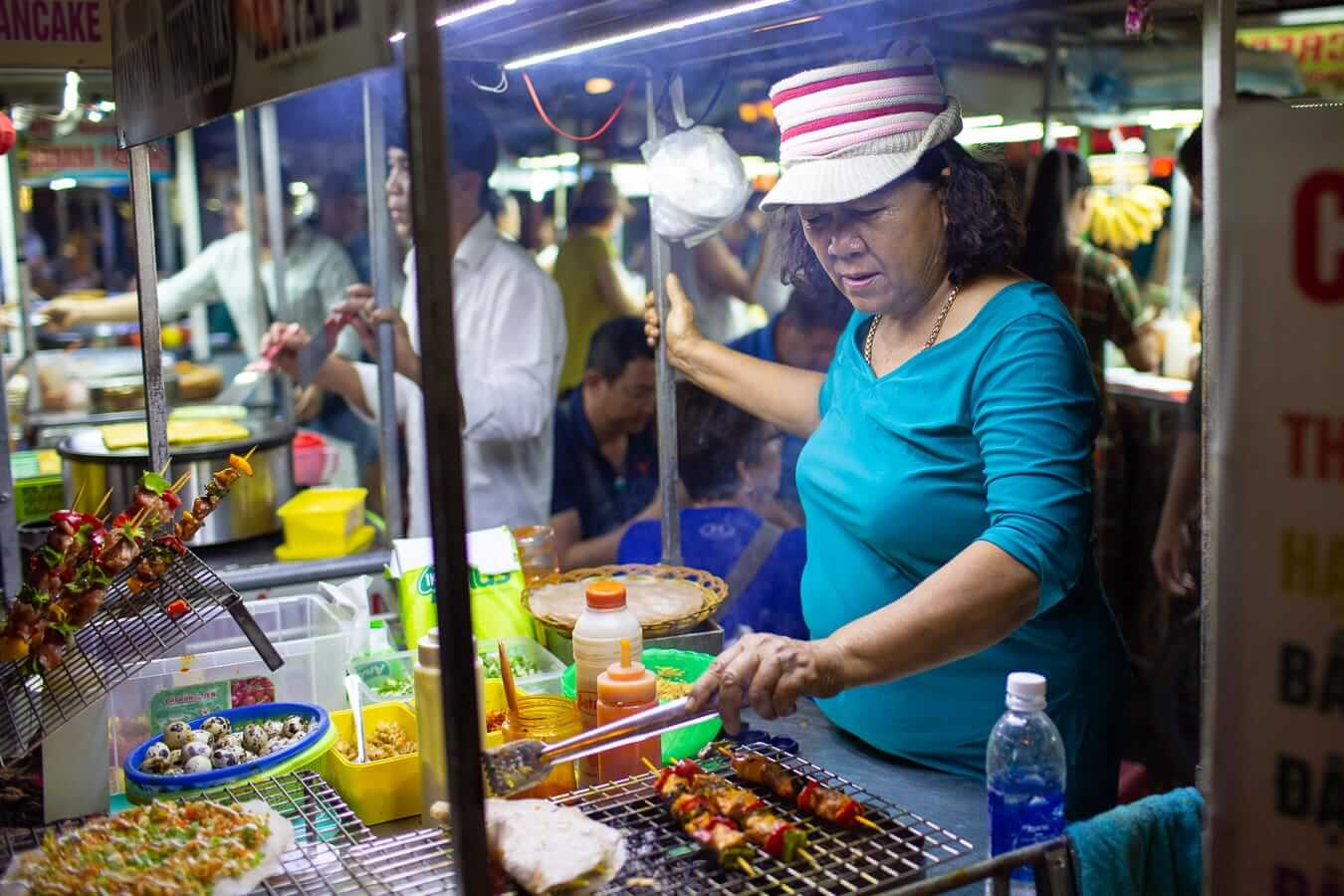 a woman tends to her food stall