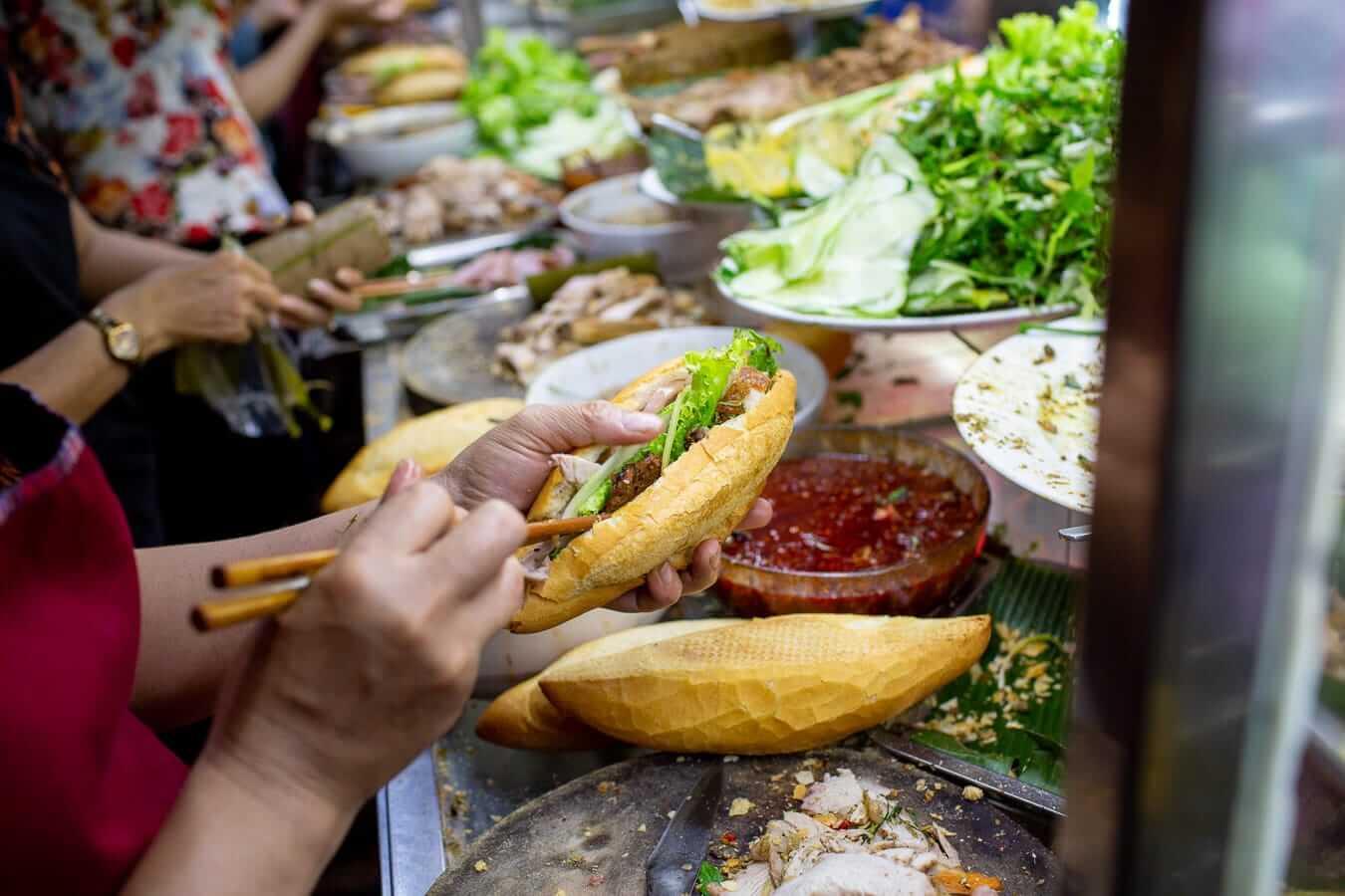 Banh mi being made at the busy Banh Mi Phuong counter
