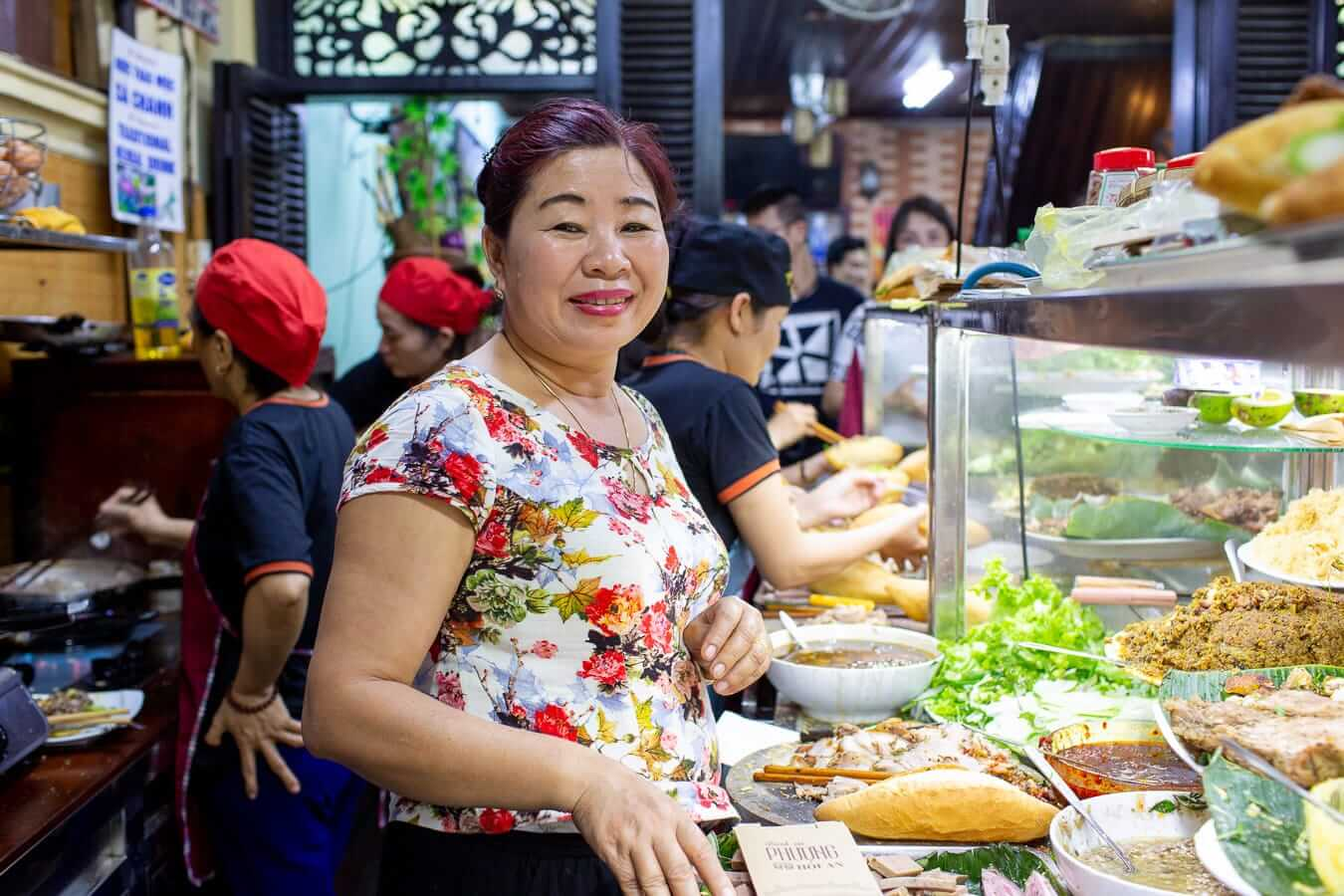 Madame Phuong working alongside her staff at Banh Mi Phuong