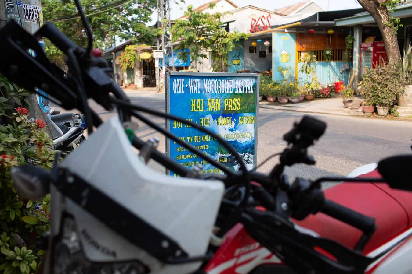 Sign advertising the Hai Van Pass motorcycle trip: Motorbike Rental Shops in Hoi An