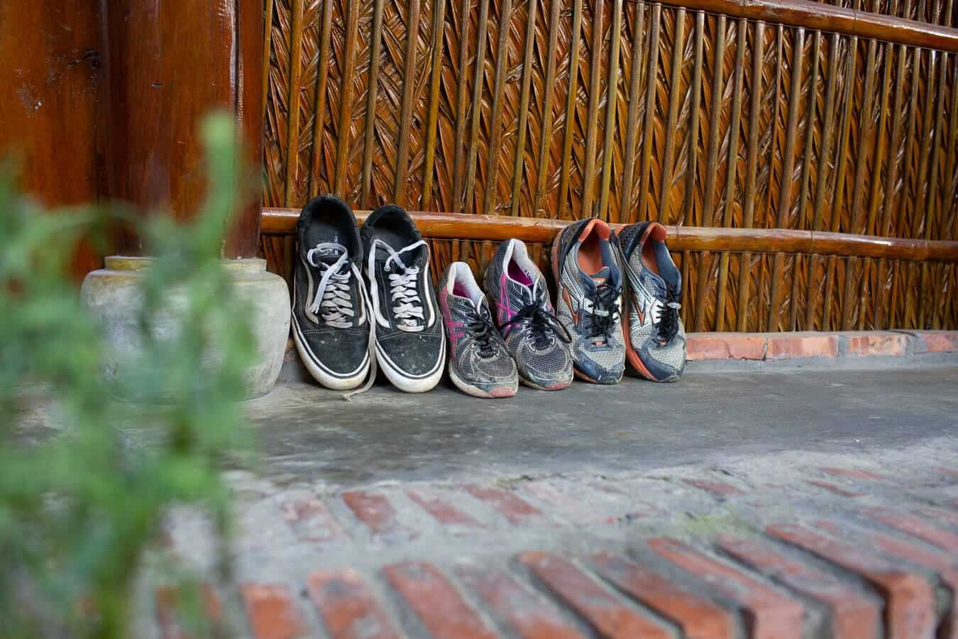 Under The Coconut Tree Hostel - row of shoes