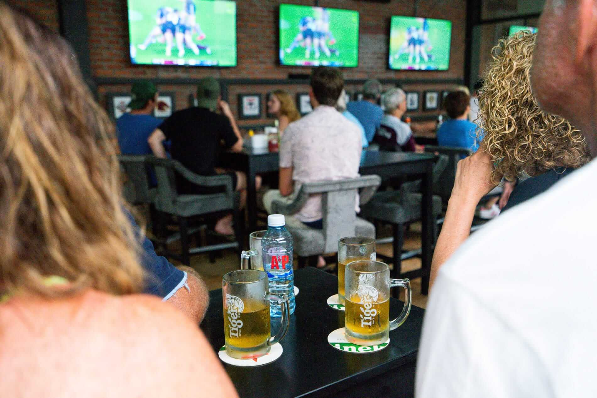 Beer and tv screens at a sports bar
