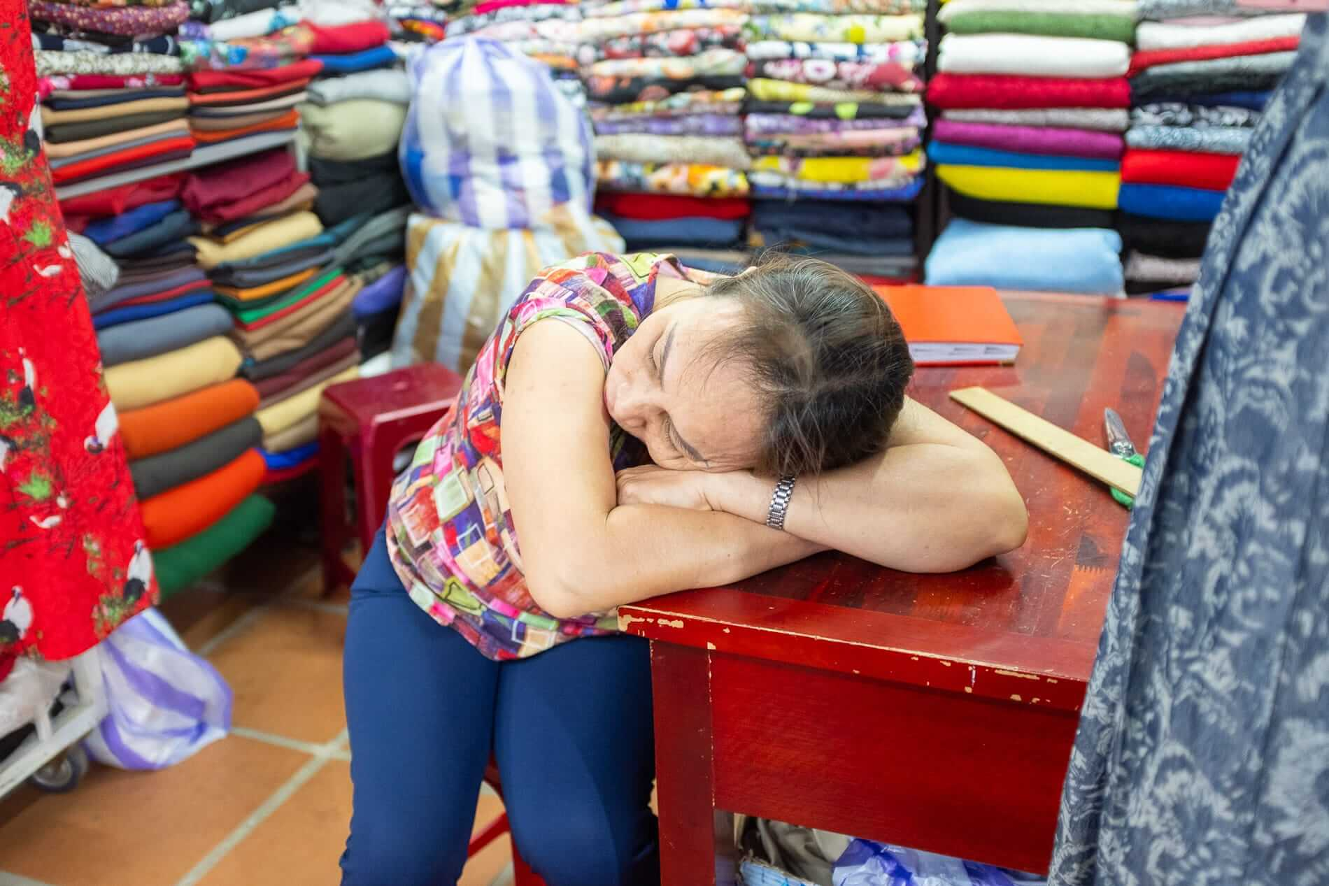 A stall holder sleeping