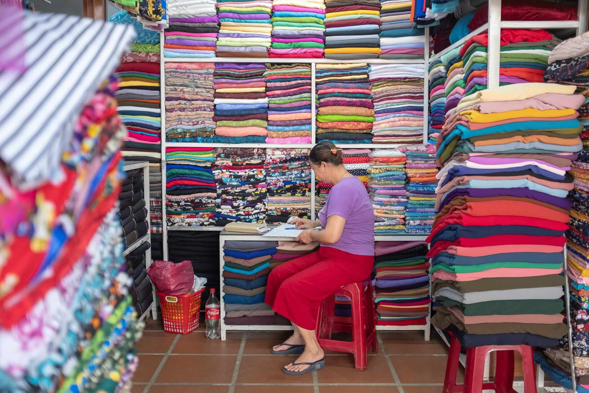 A stall with colourful fabrics - Fabric Market