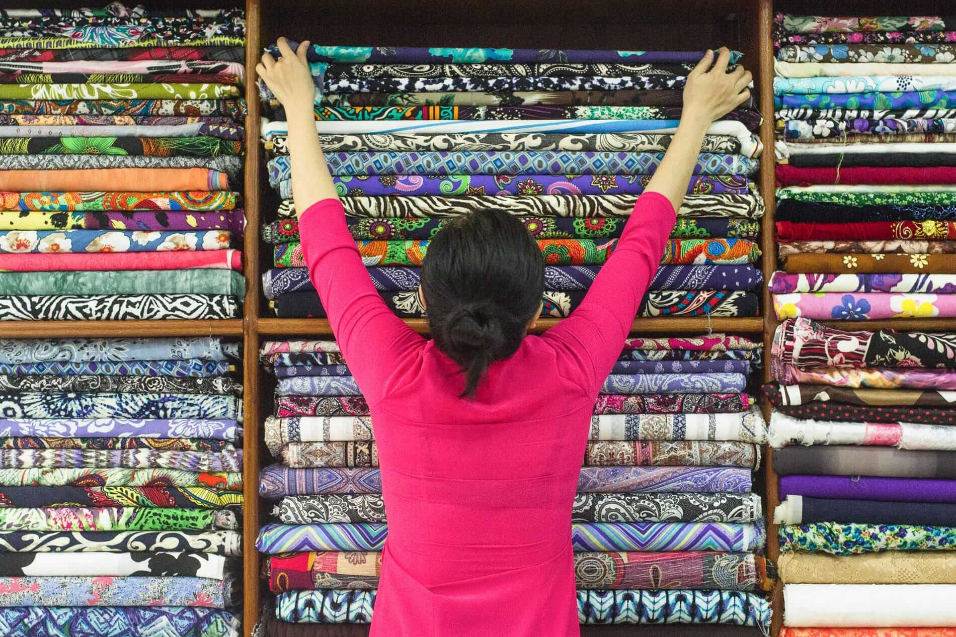 Tailoring sales staff with large amounts of fabric