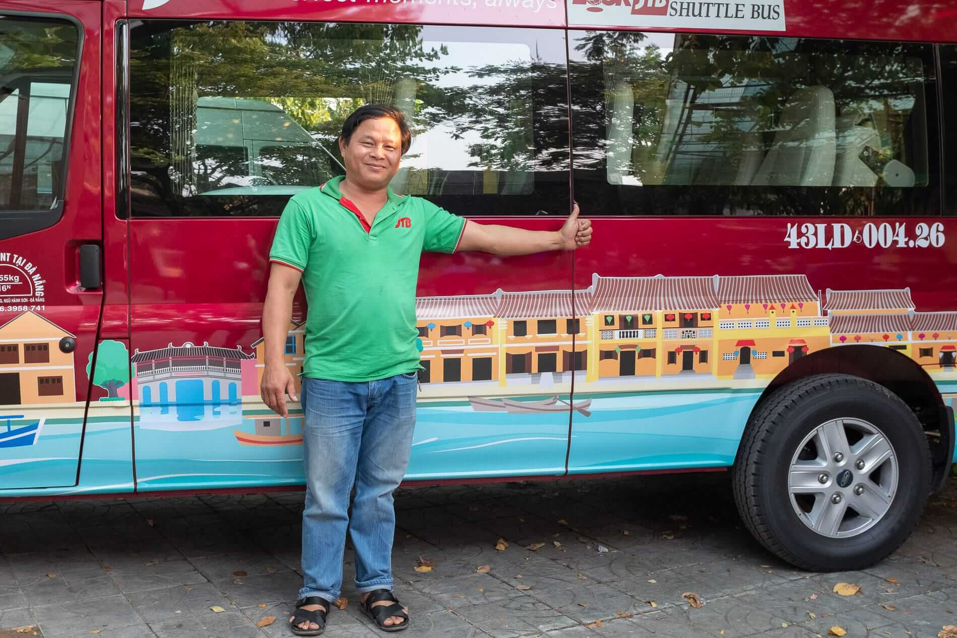 Minibus driver poses on his vehicle - Transfer Services