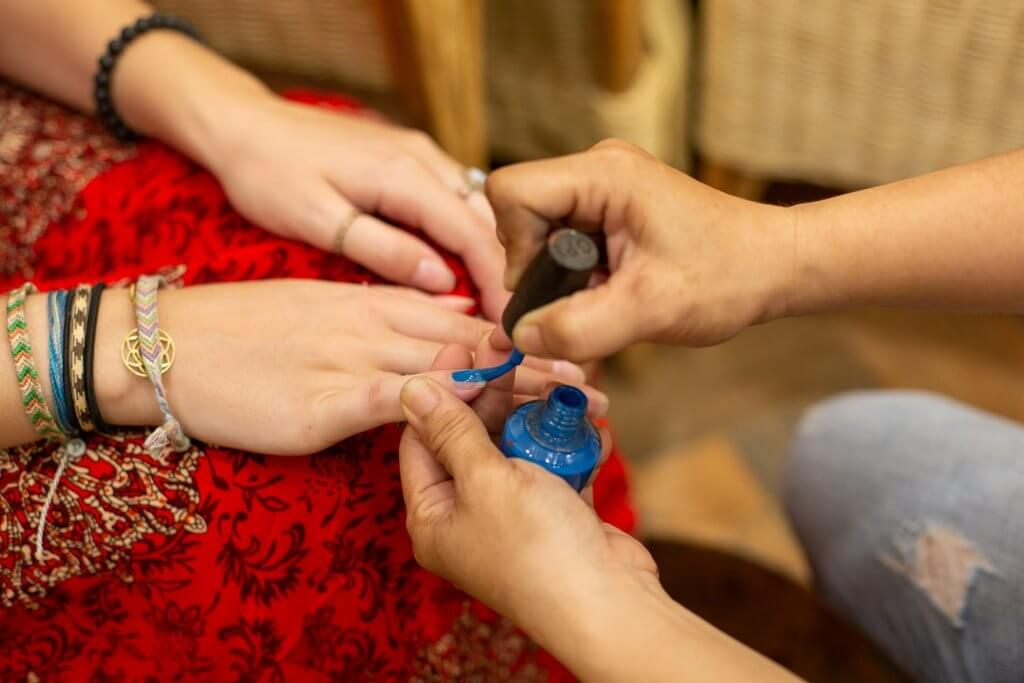 blue nail polish being applied