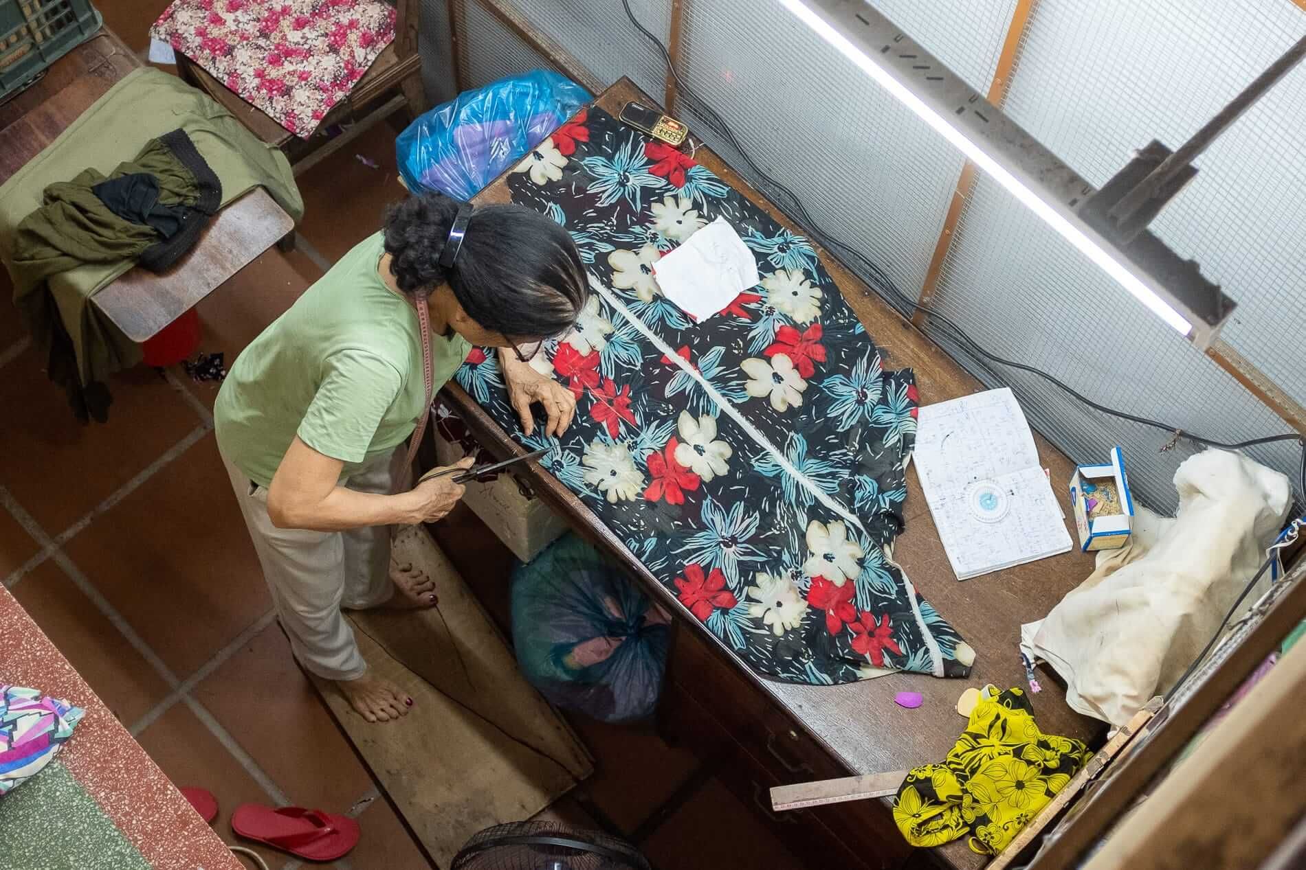 Tailor working on garment