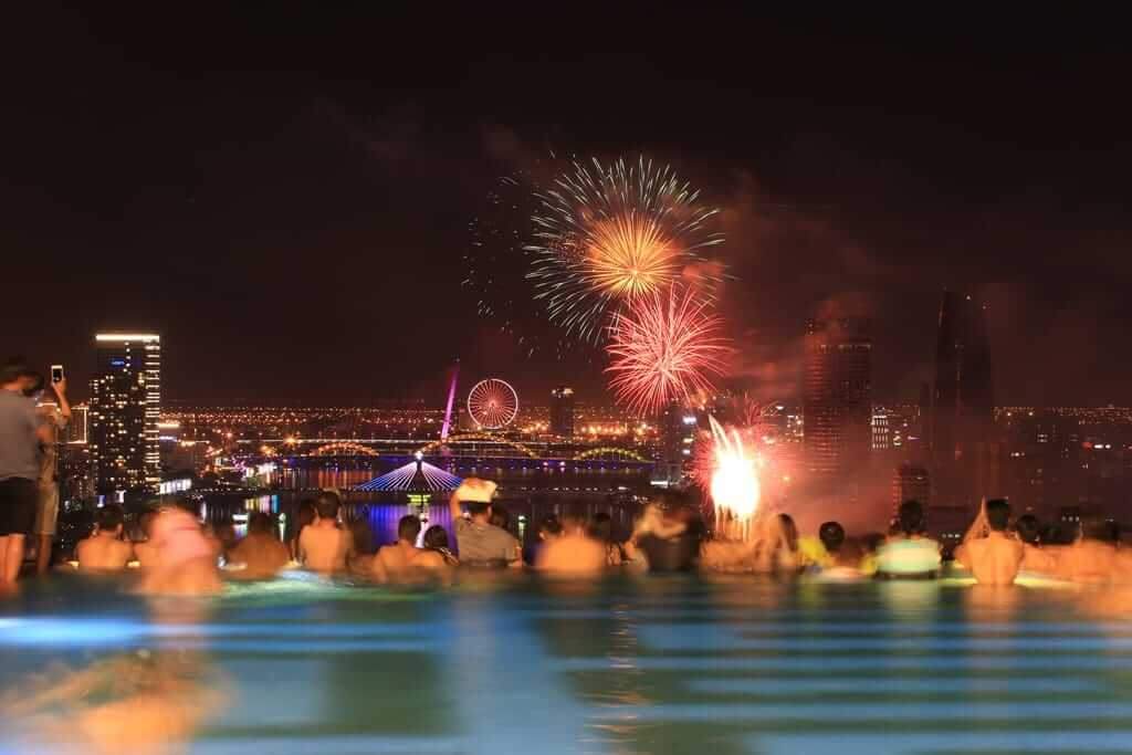 A group watch the Da Nang fireworks