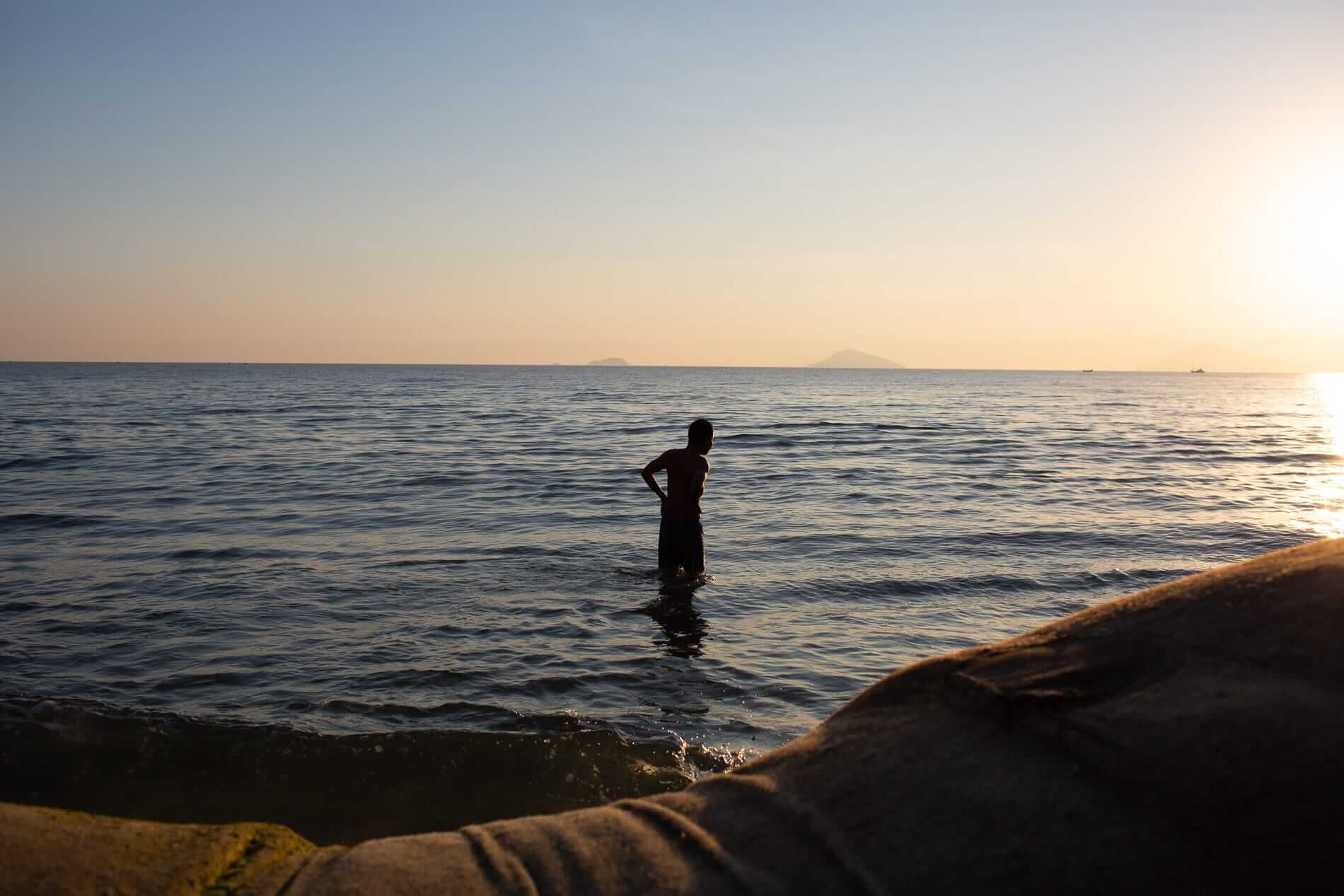 Bathing at sunrise in Hoi An