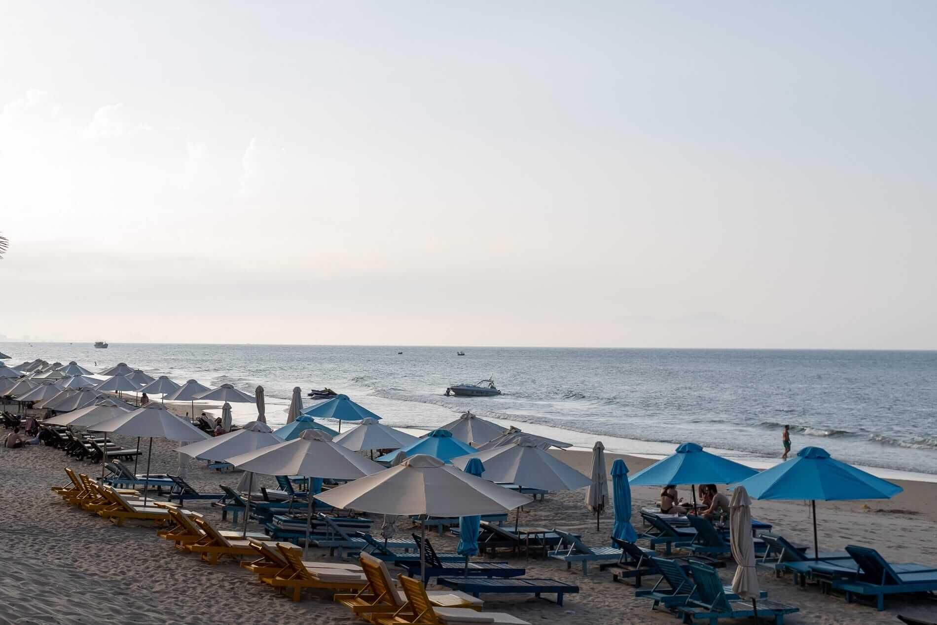Sunloungers line the beach in Hoi An