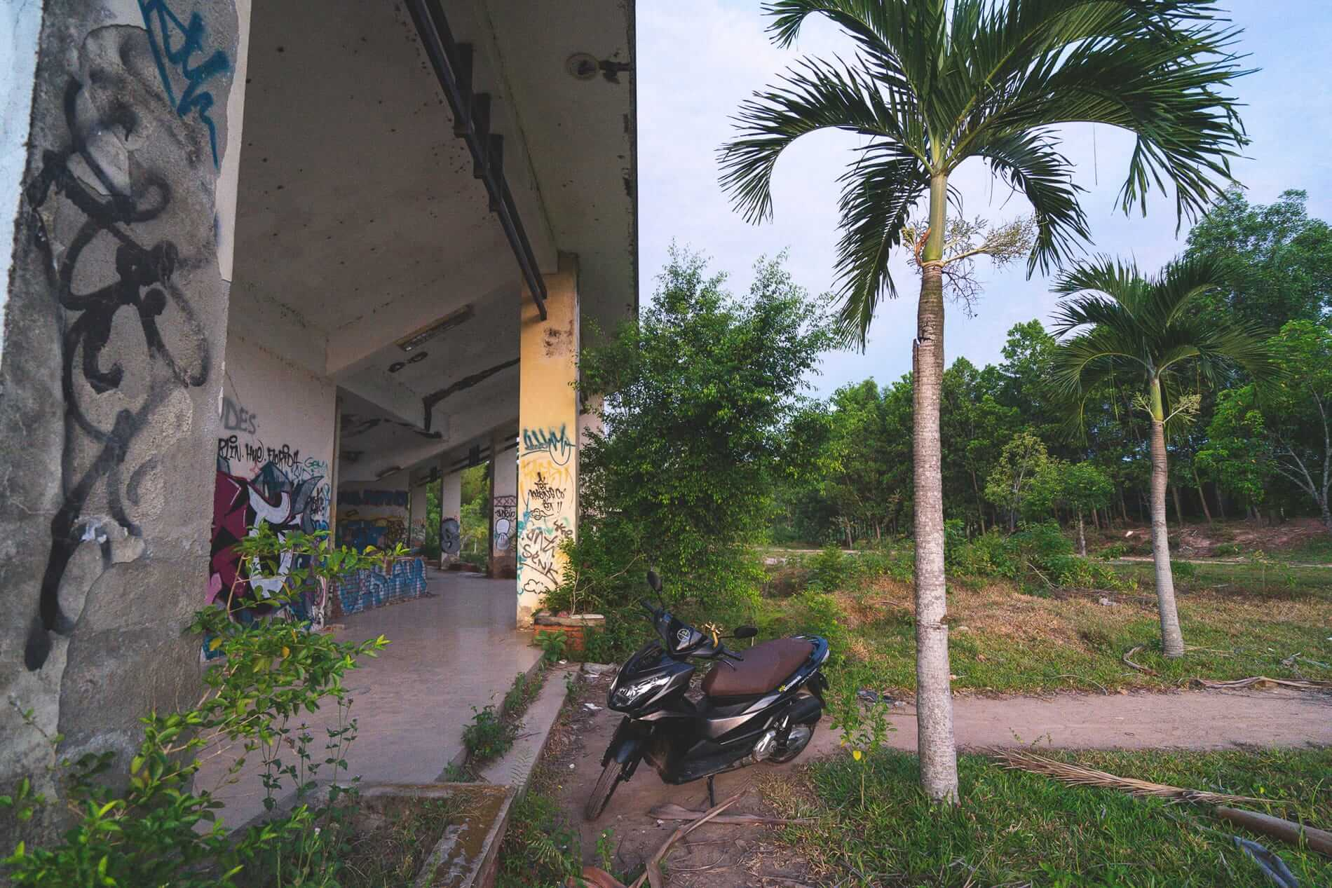 Parked motorcycle - Graffiti everywhere - Hues Abandoned Water Park