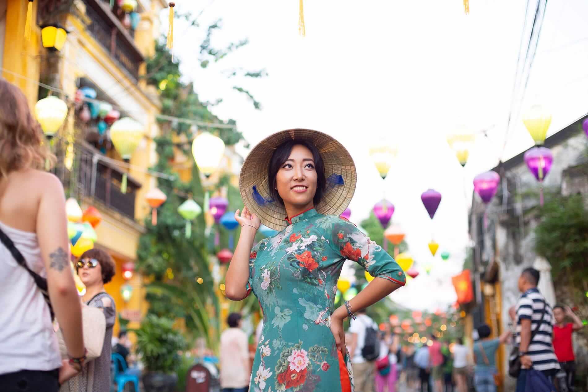 Tourist wearing her ao dai - Hoi An Ancient Town