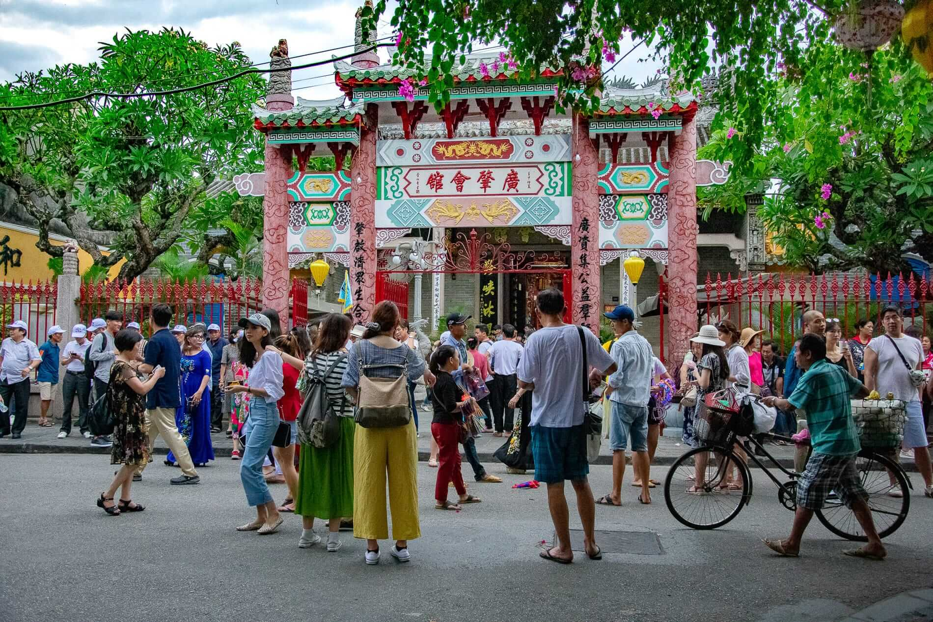 Tourists gather at the exterior of the Quang Trieu - Hoi An Ancient Town