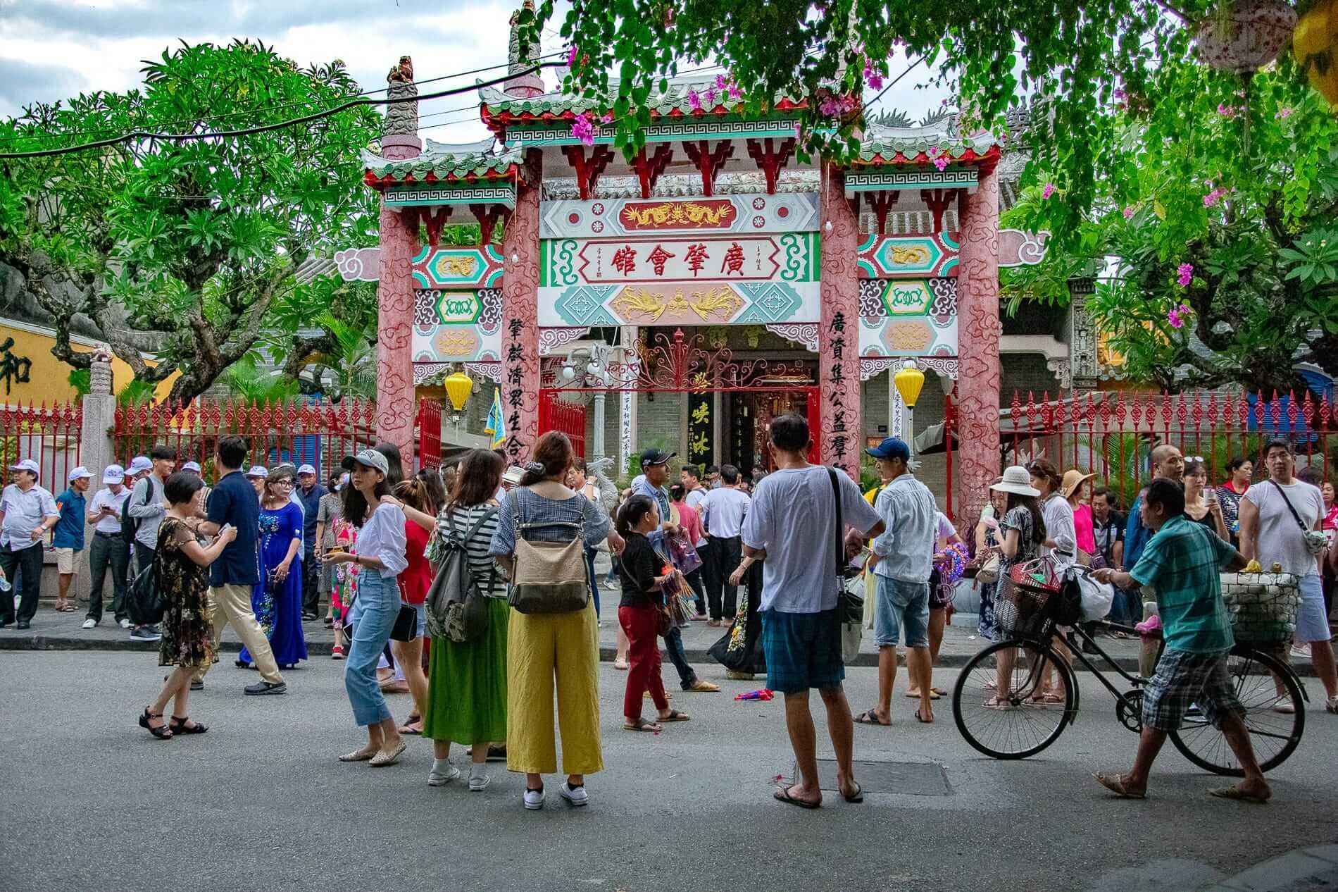 Tourists gather at the exterior of the Quang Trieu - Hoi An Ancient Town