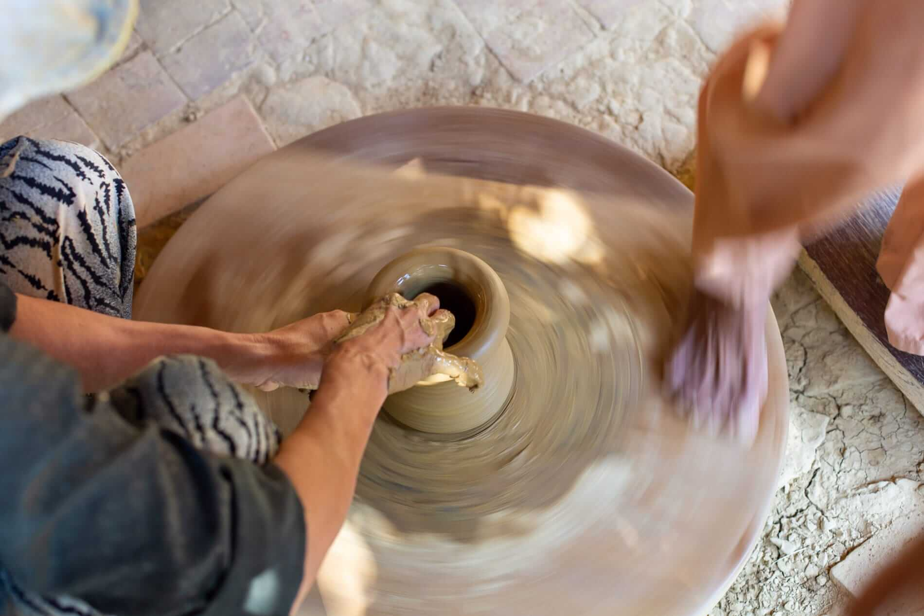 Foot spun pottery wheel - Pottery Village