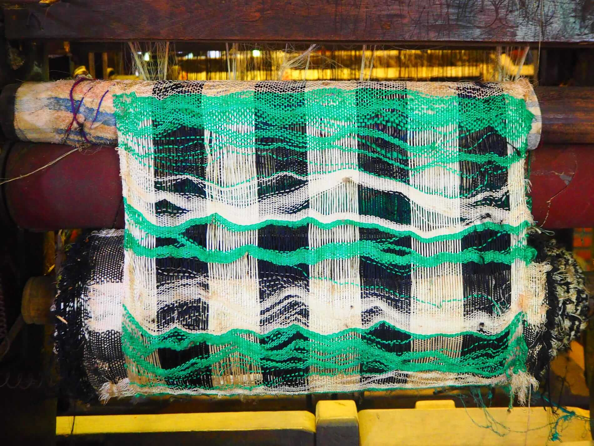 Silk being worked into cloth -Hoi An Shopping Guide