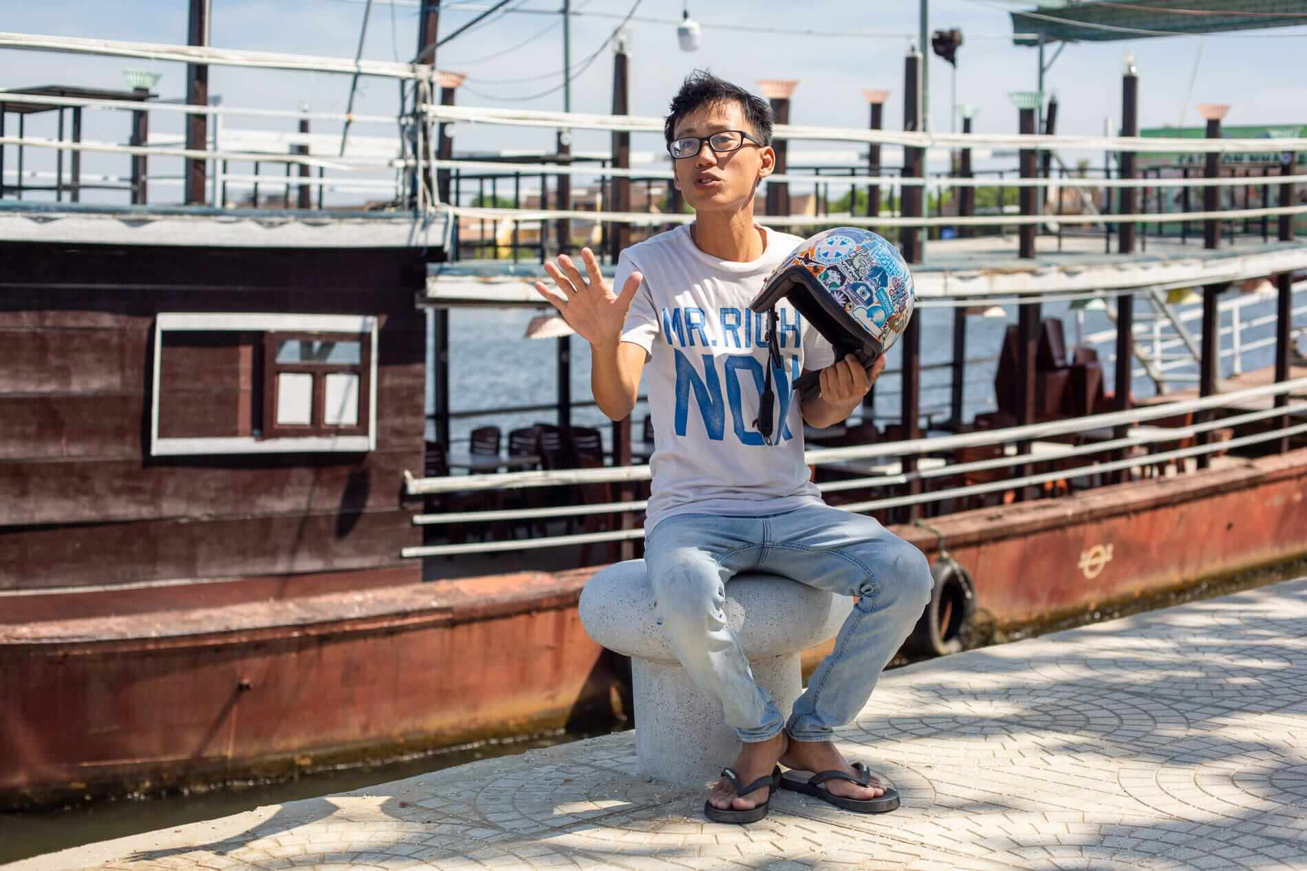 Thanh in front of the floating restaurant - What to do in Hoi An