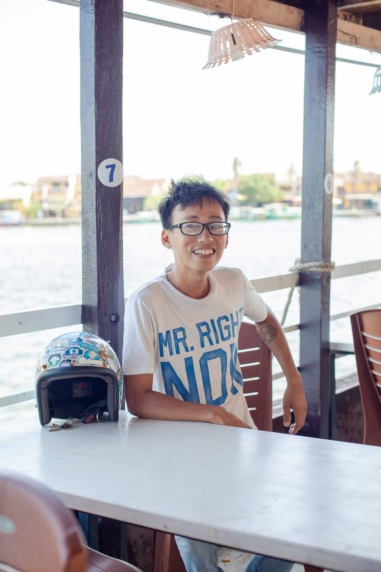 Thanh sitting on the boat - What to do in Hoi An