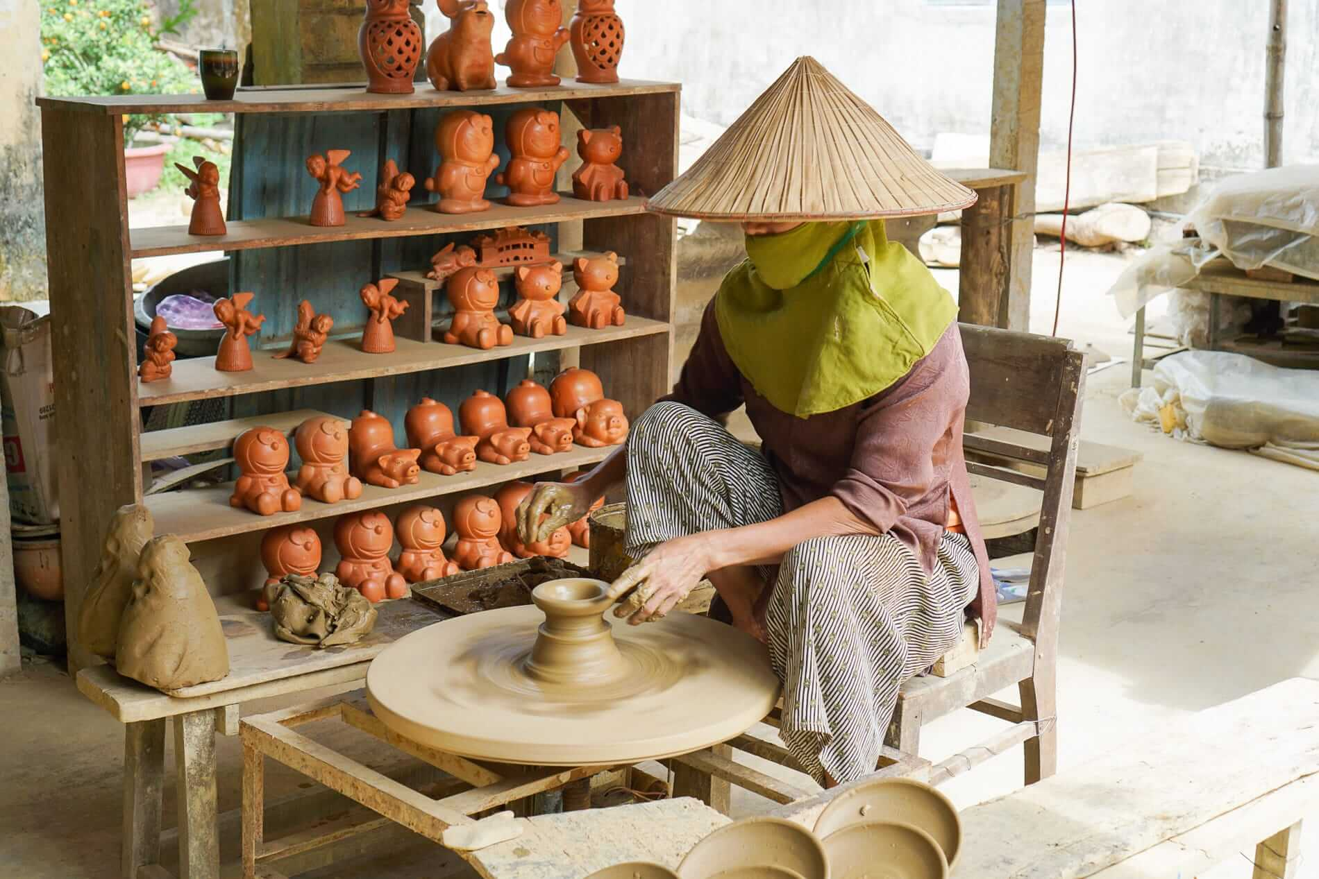 Woman At Pottery Wheel