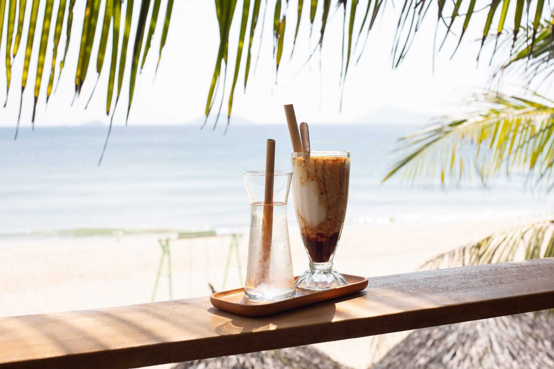 A coconut coffee and beach view at Sound of Silence Coffee