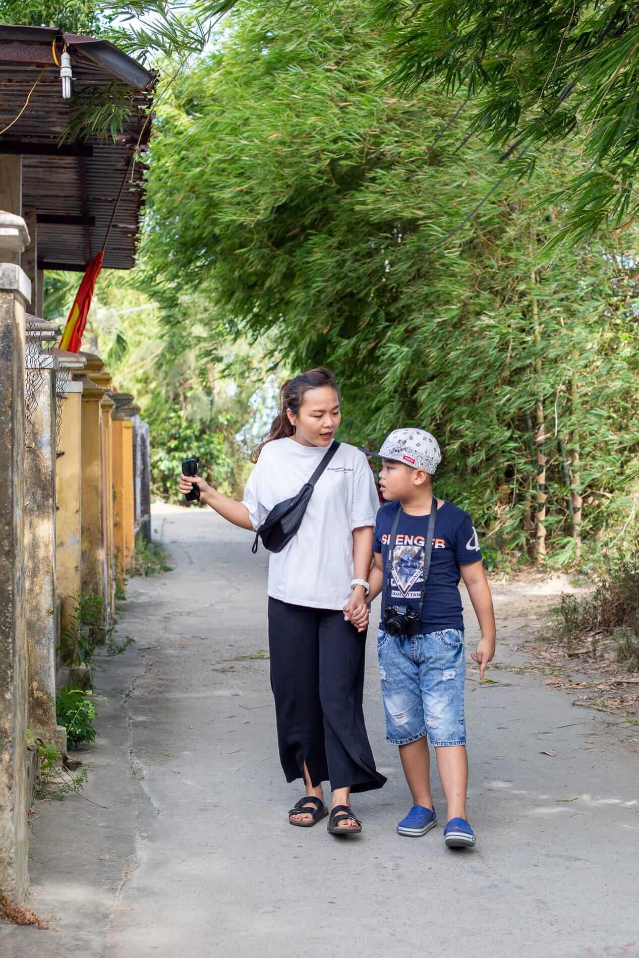 Ai Phi and son exploring Hoi An