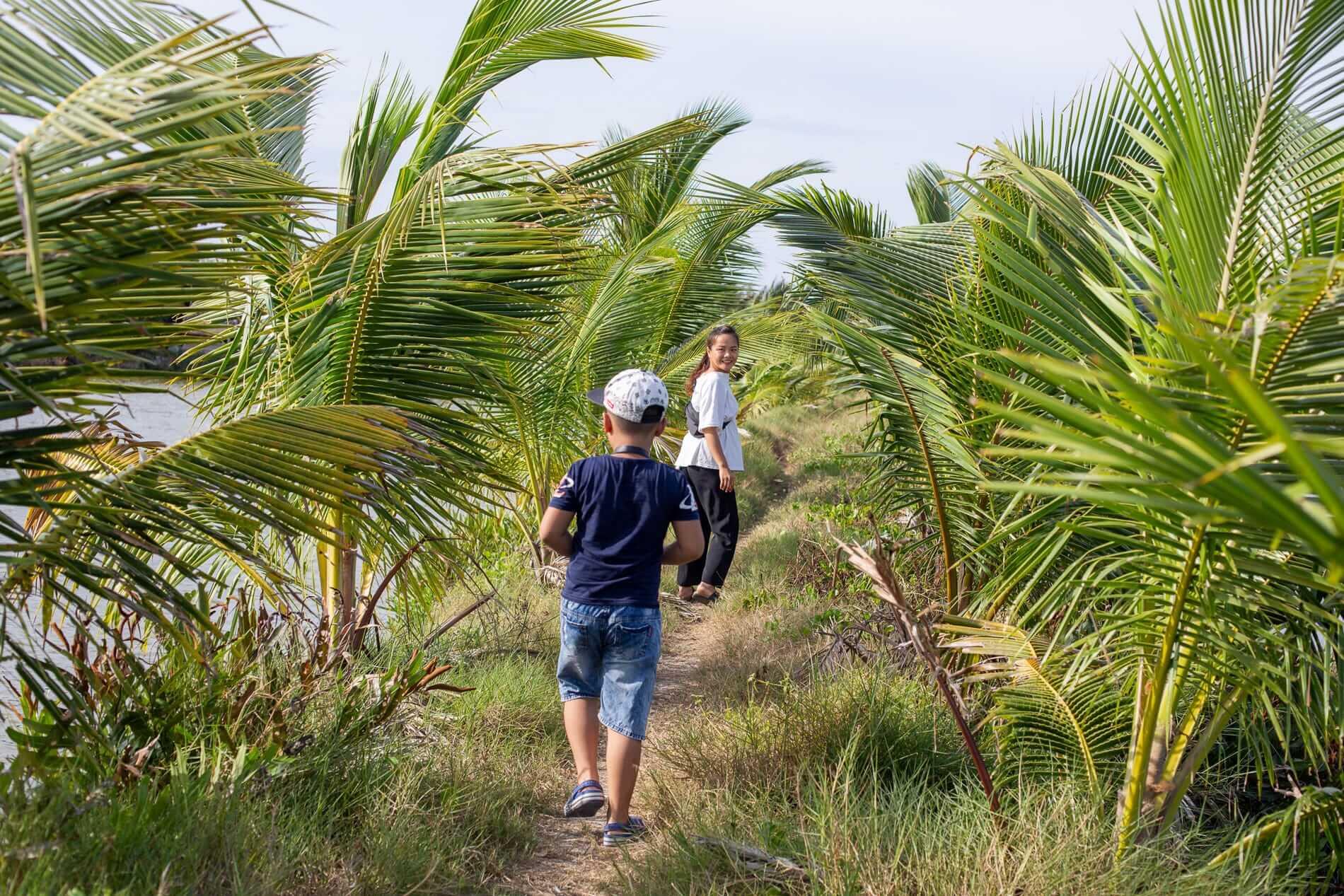 Ai Phi and son exploring Tra Que Village
