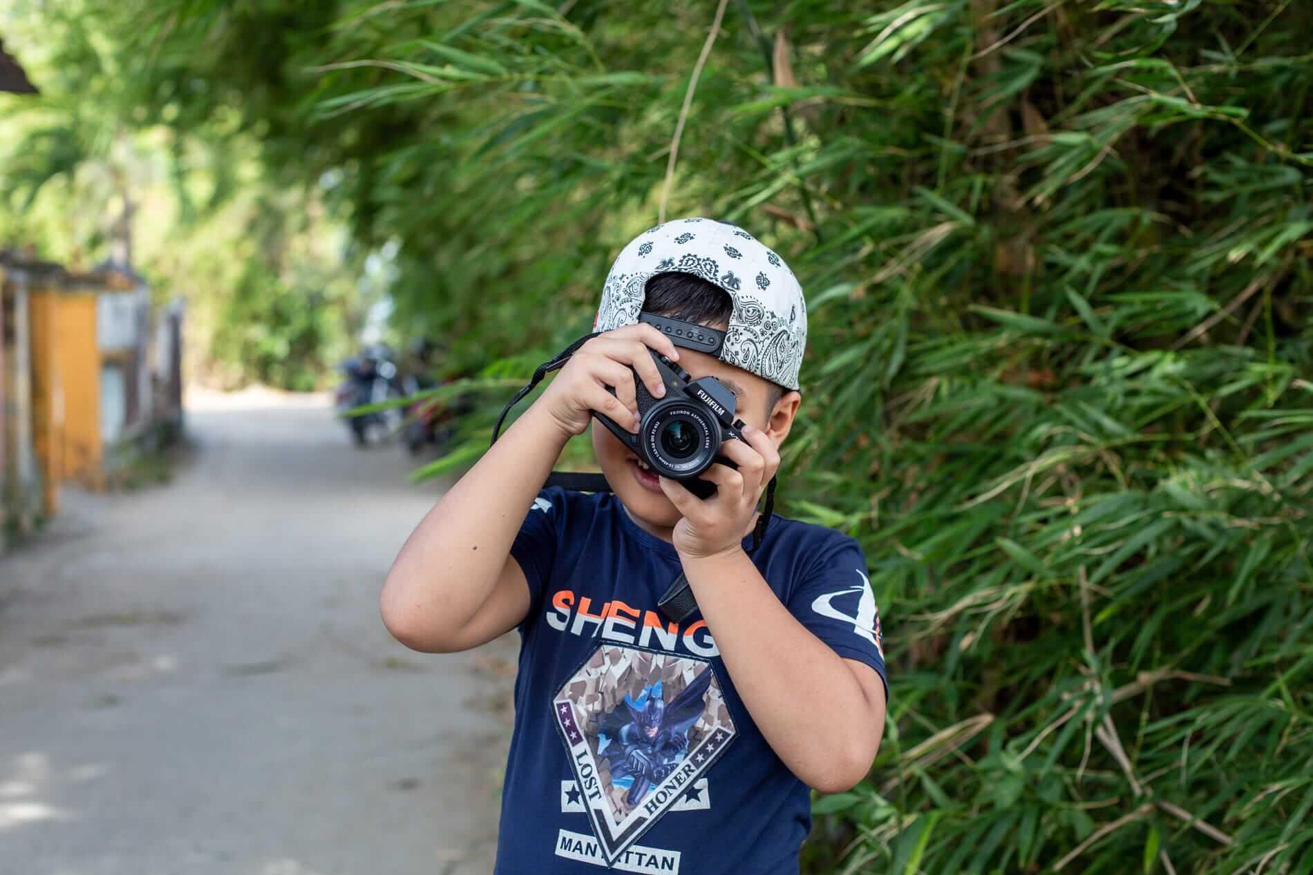 Ai Phi's son enjoying photography