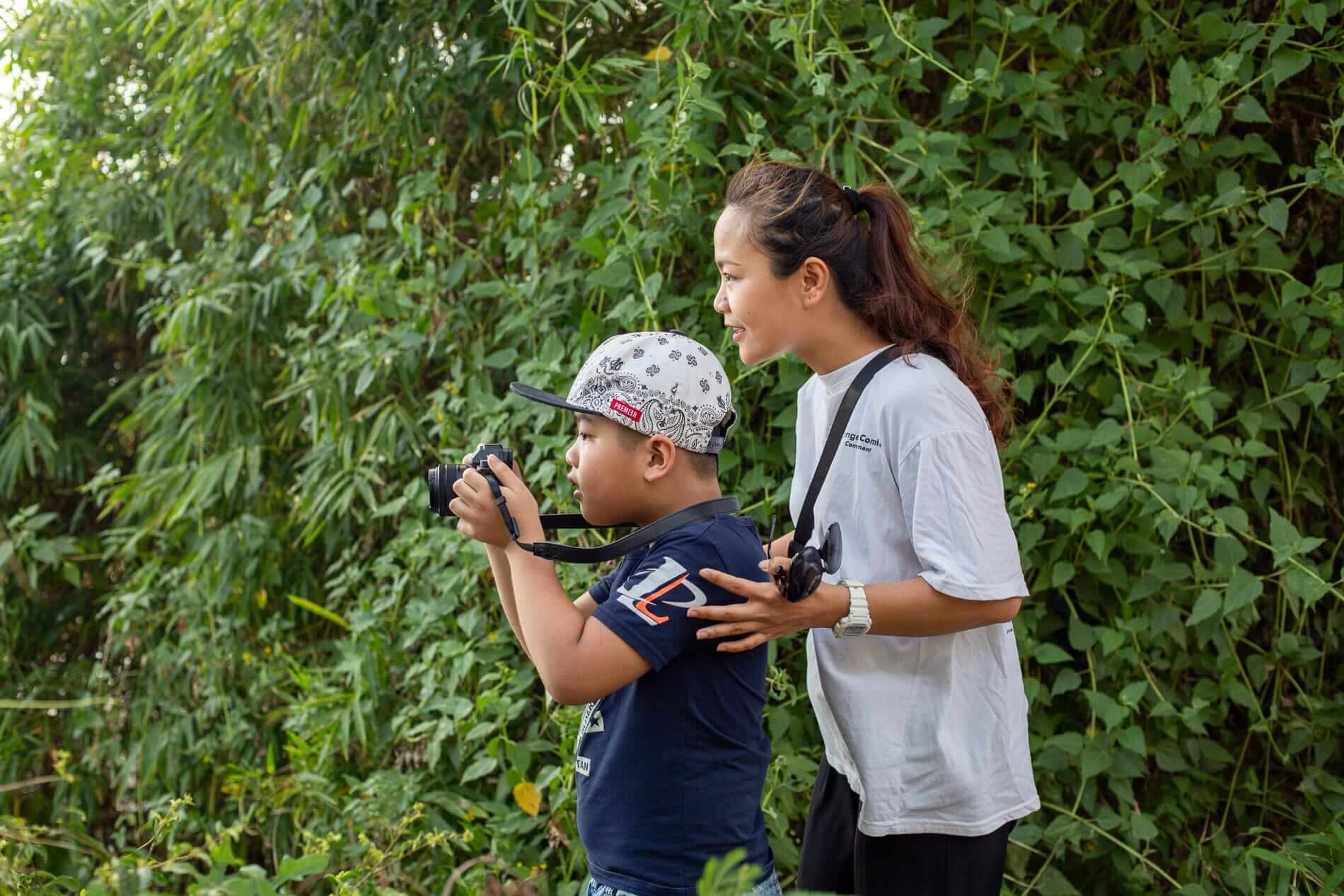 Ai Phi teaches her son photography - What to do in Hoi An