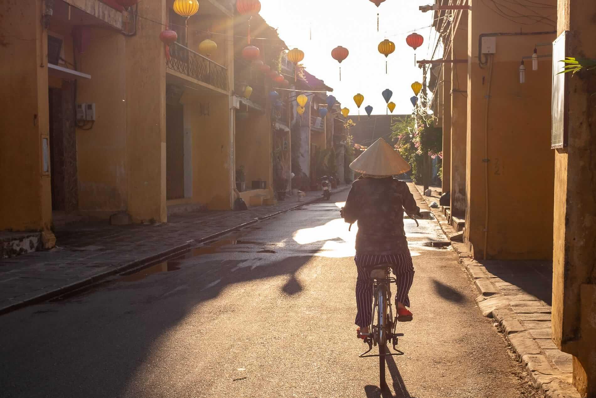 Cyclist rides through Hoi An Ancient Town