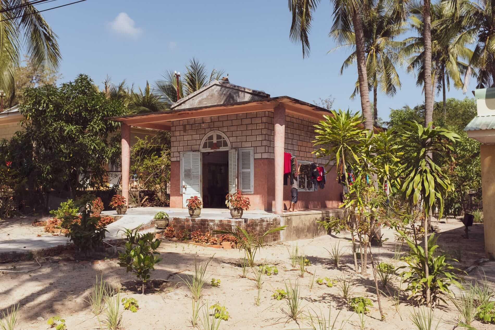 An Art Deco house under palm trees