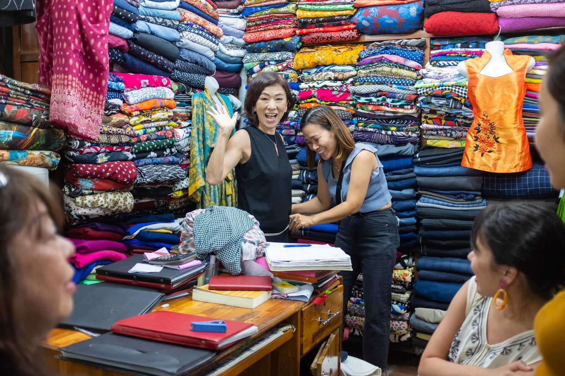 Excited customer getting her fit at Hoi An Tailor Market
