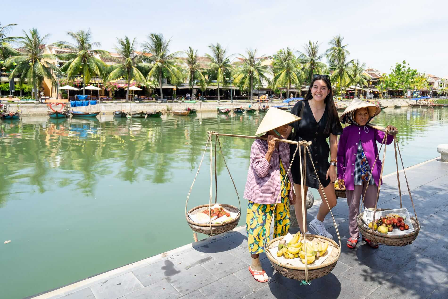 Fruit sellers with tourist - Hoi An Ancient Town