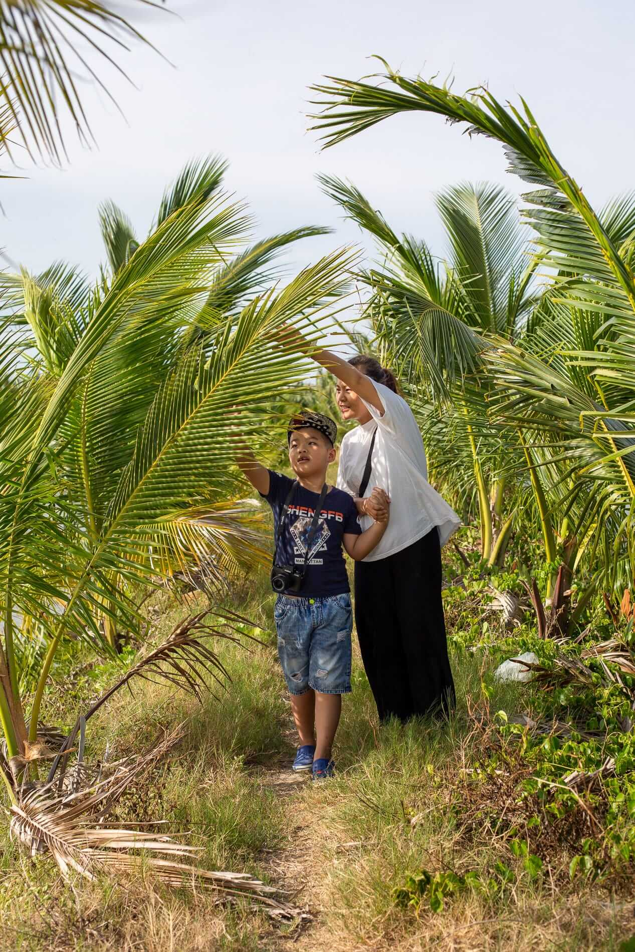 Mother and son exploring rice paddies and Tra Que Village