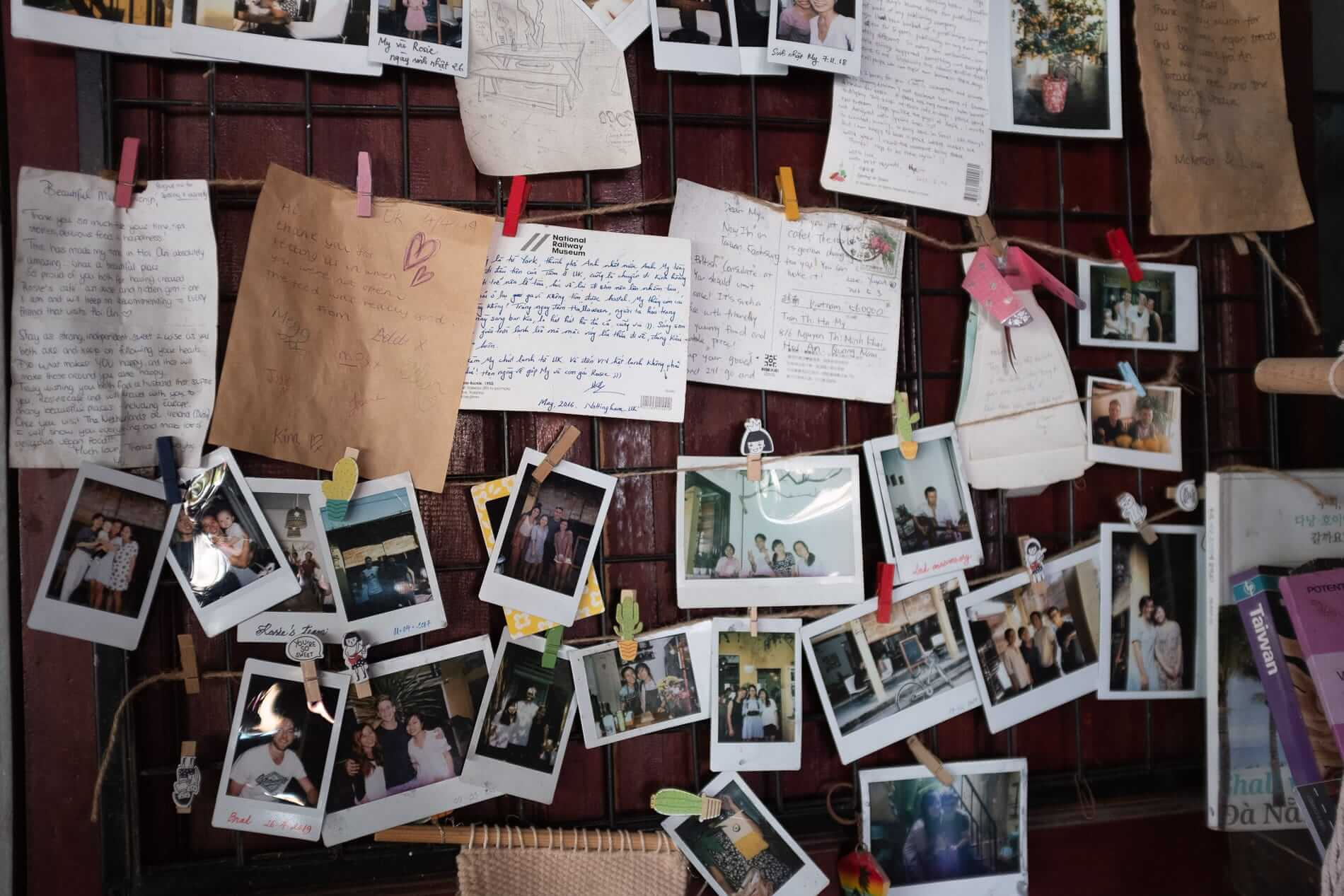 A noticeboard covered with notes and postcards