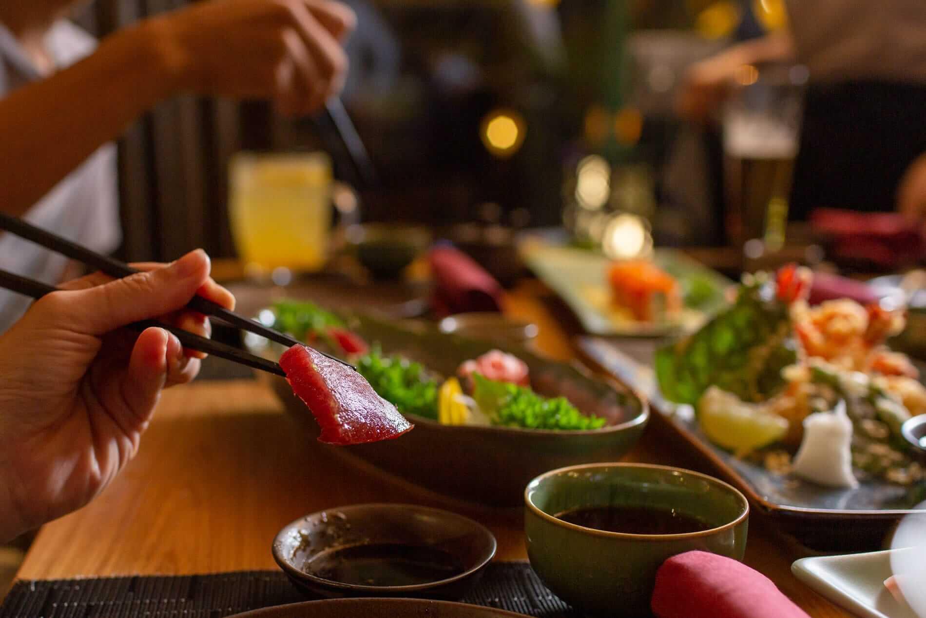 Tuna sashimi and chopsticks