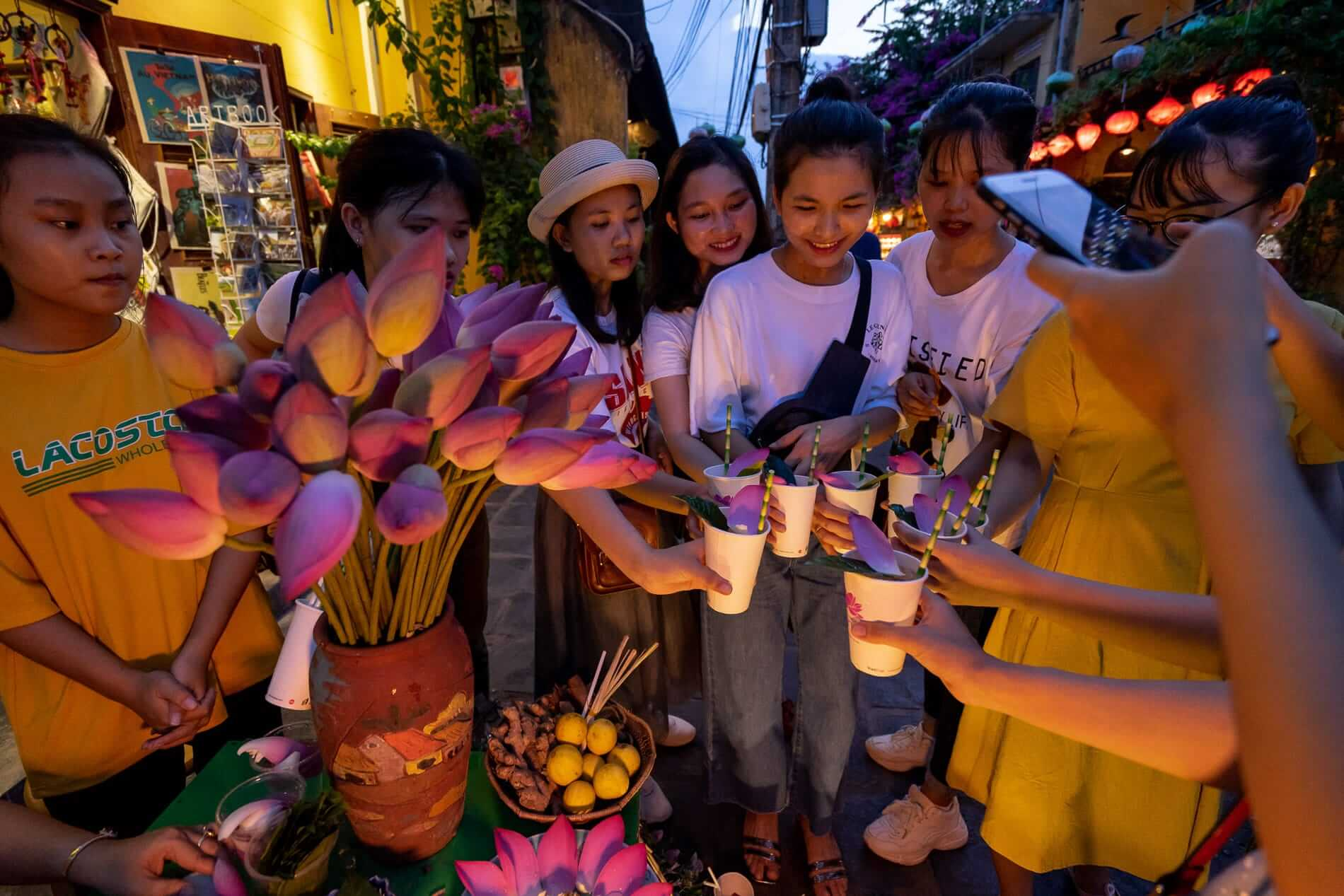 A group enjoying a herbal tea on the street