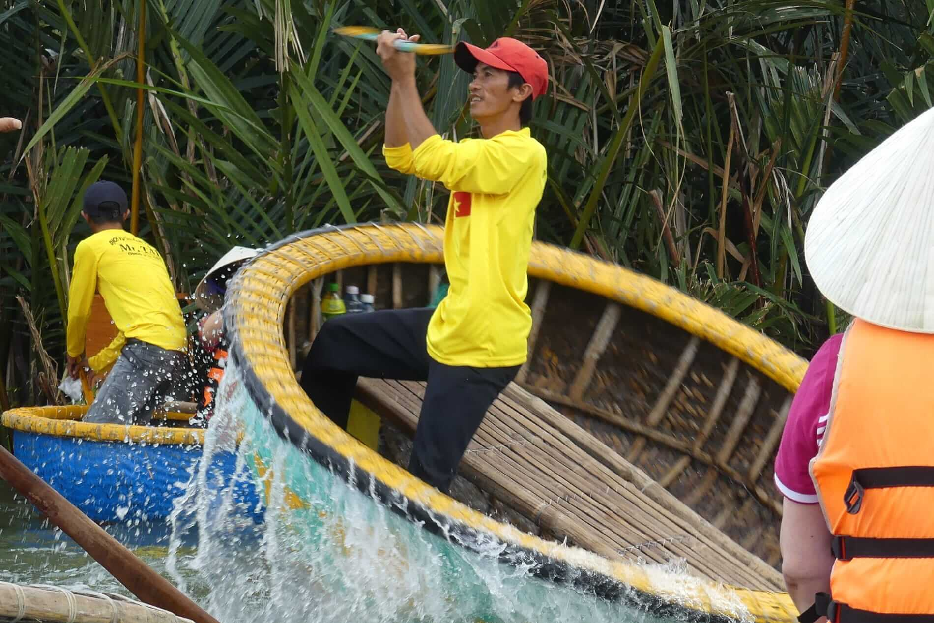 Spinning a bamboo boat to entertain visitors
