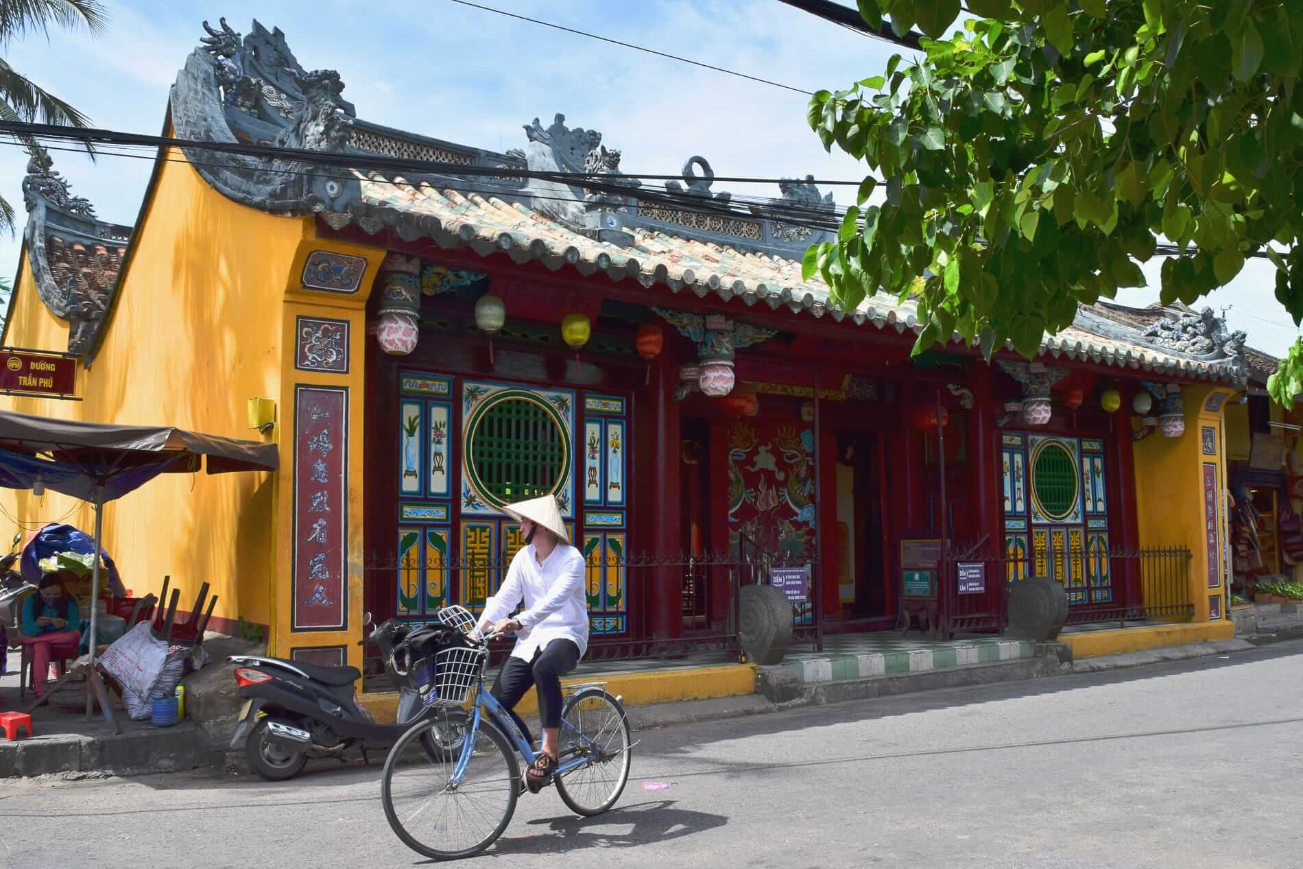 cyclist passes Quan Cong Temple