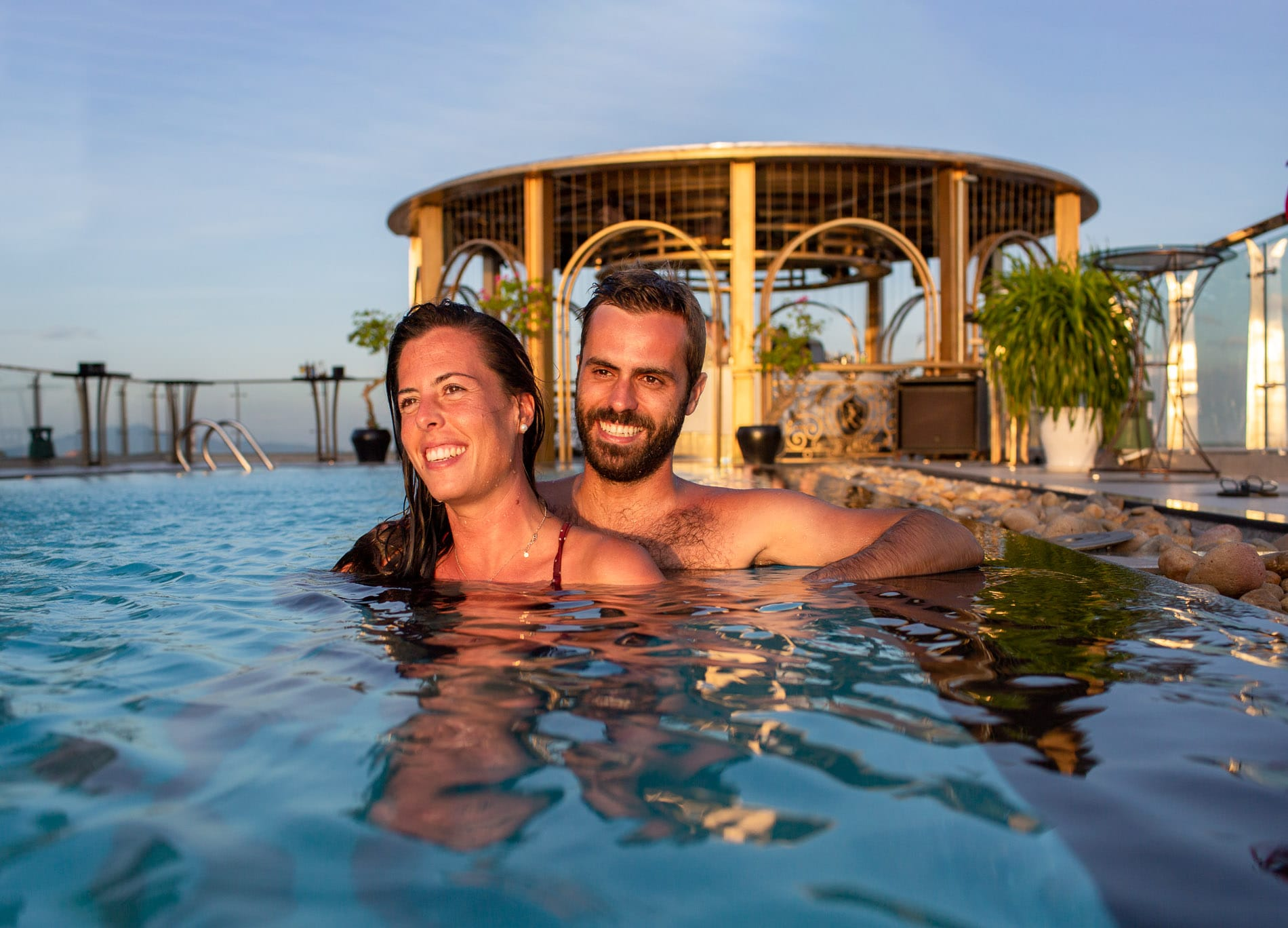 Couple in the pool at sunset