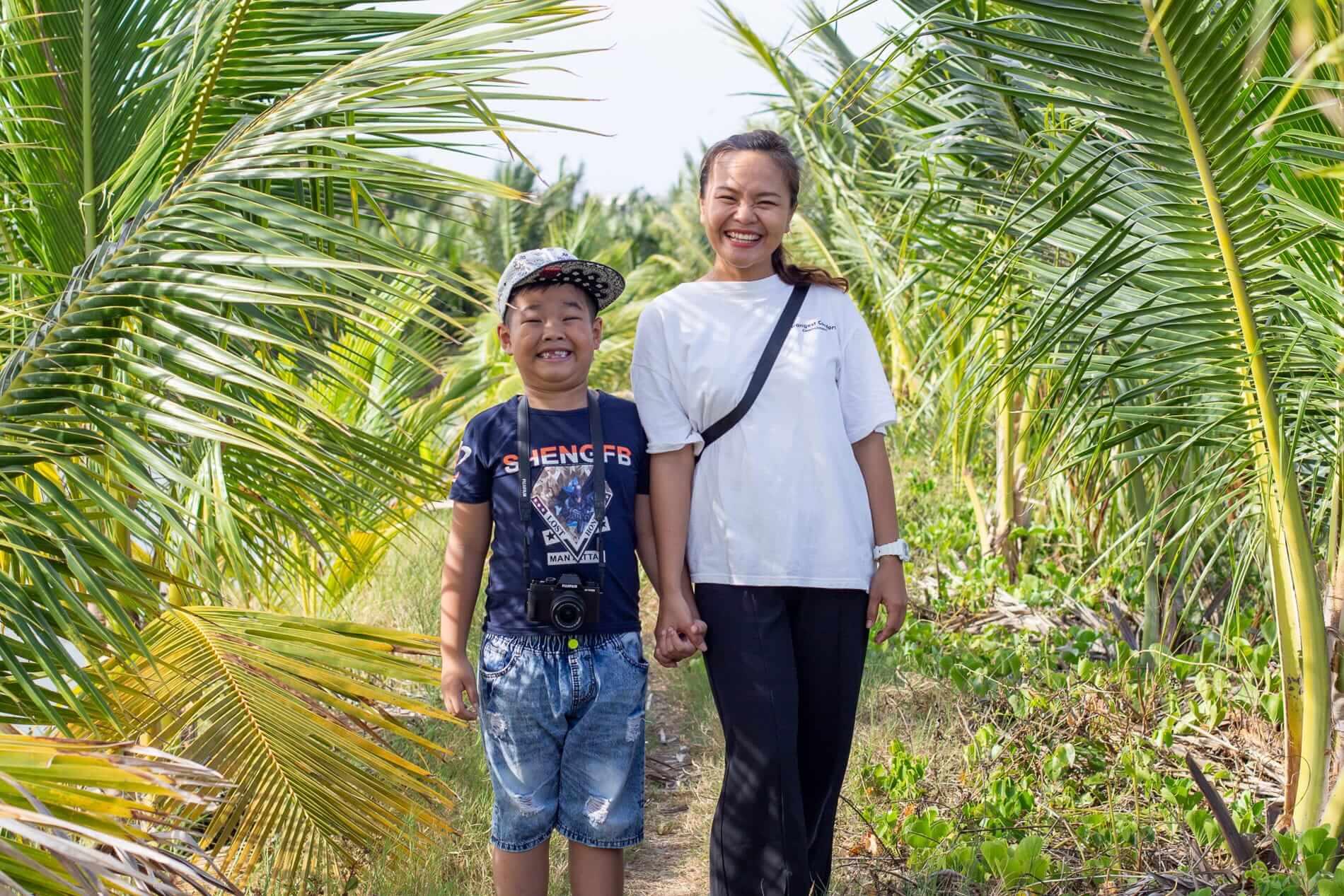 Ai Phi and her son Van Phong exploring Hoi An