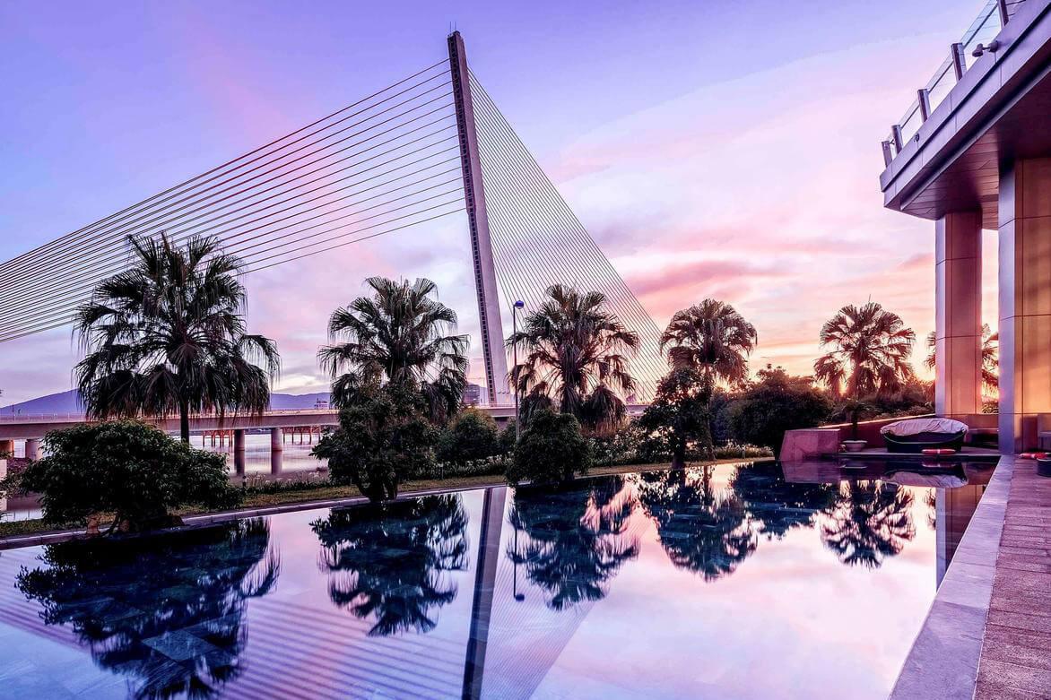 Da Nang bridges seen from the side of a hotel pool